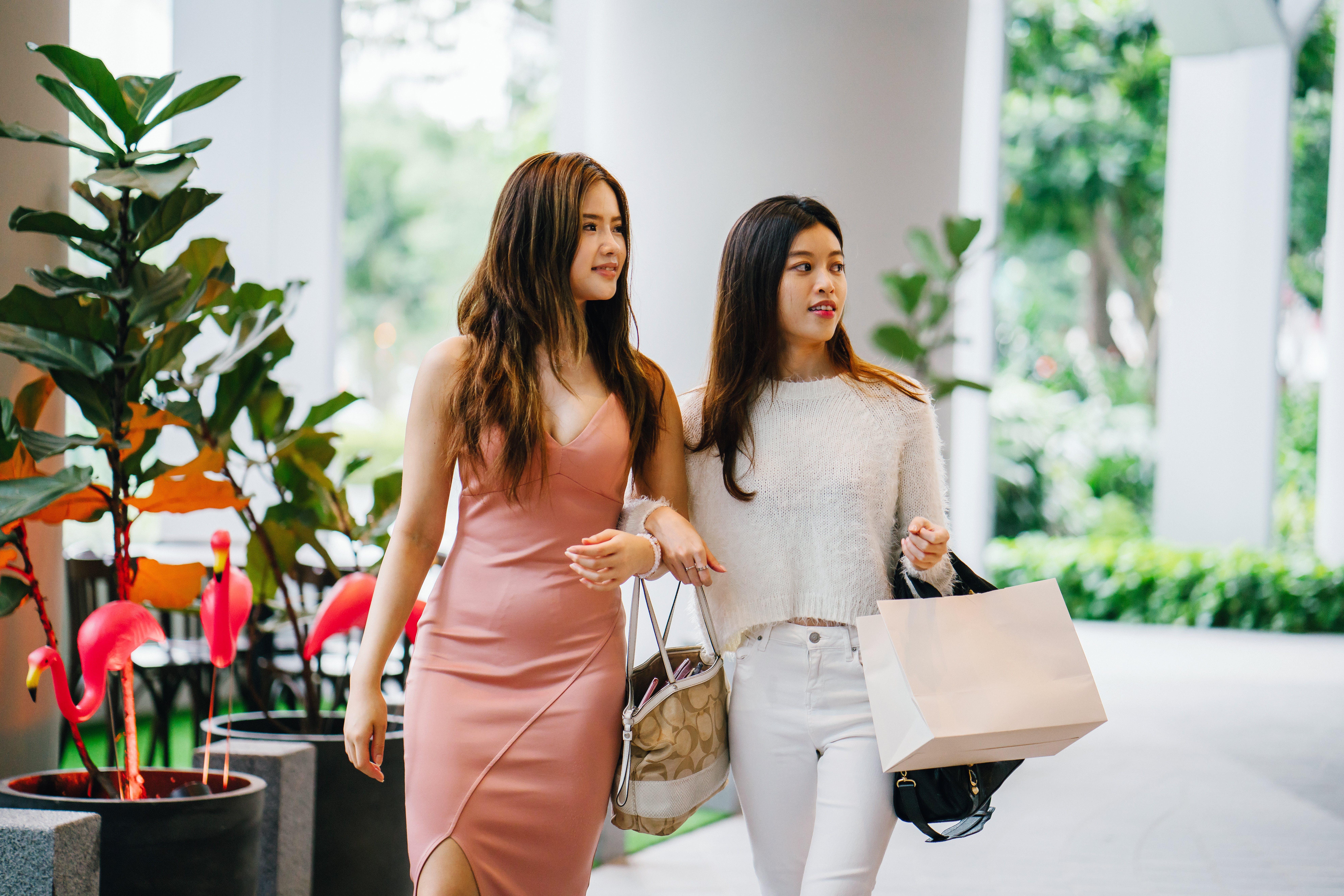 Two Women Walking Side By Side