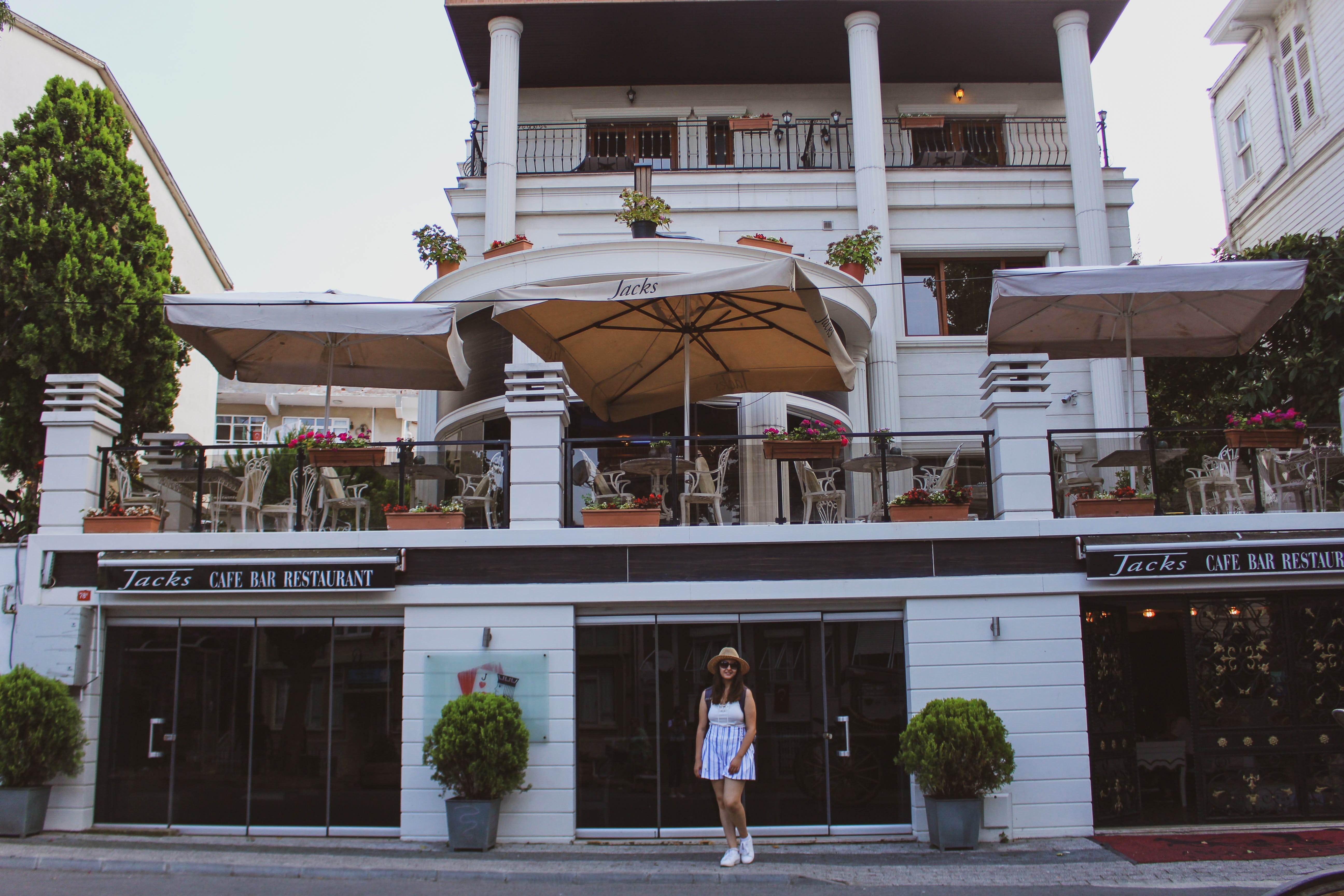 Woman Standing in Front of Restaurant