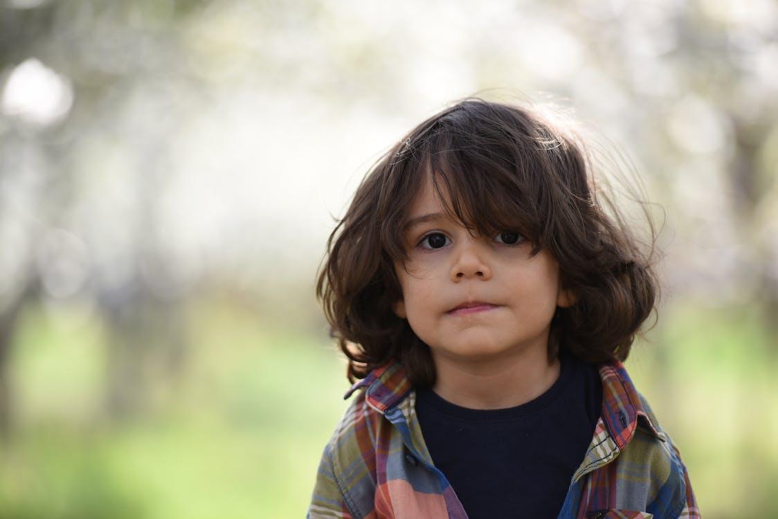 Boy Facing Camera Selective Focus Photography