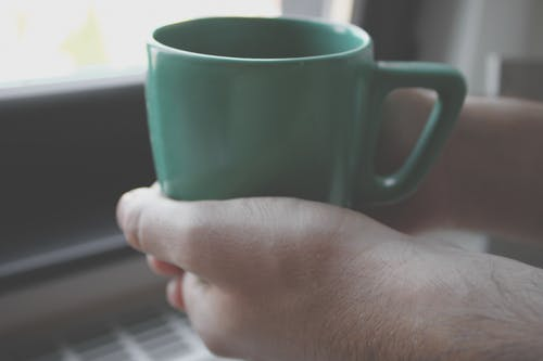 Person Holding Green Mug