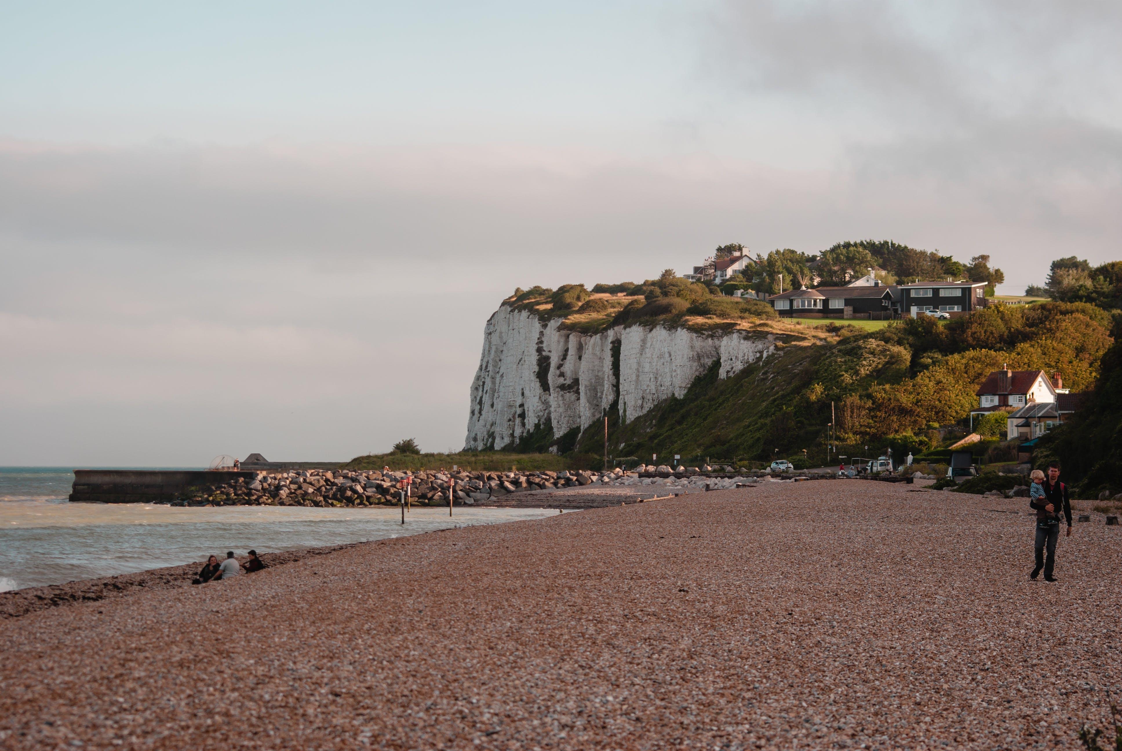 Photography of People On Seashore