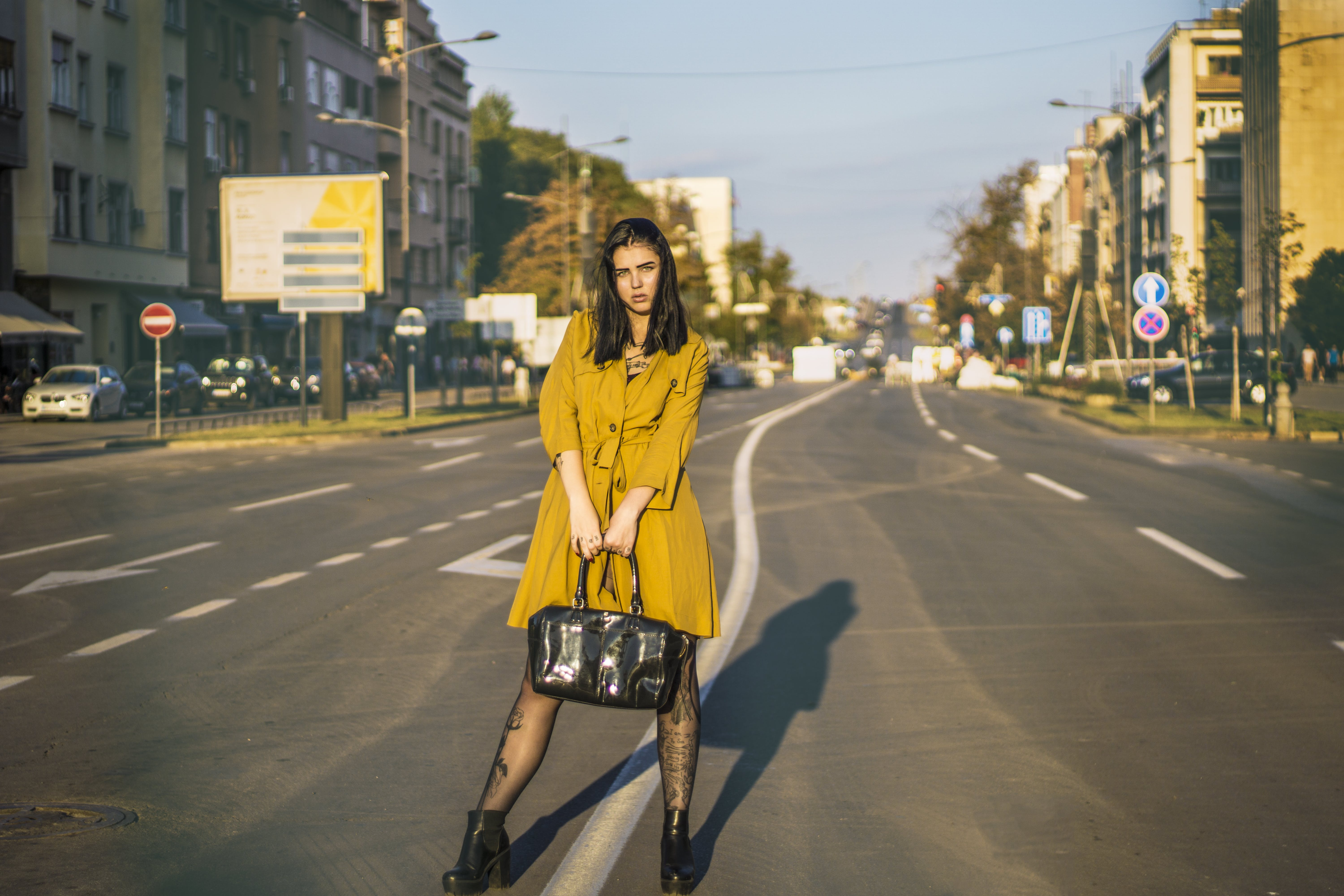 Woman Standing In The Middle Of The Road