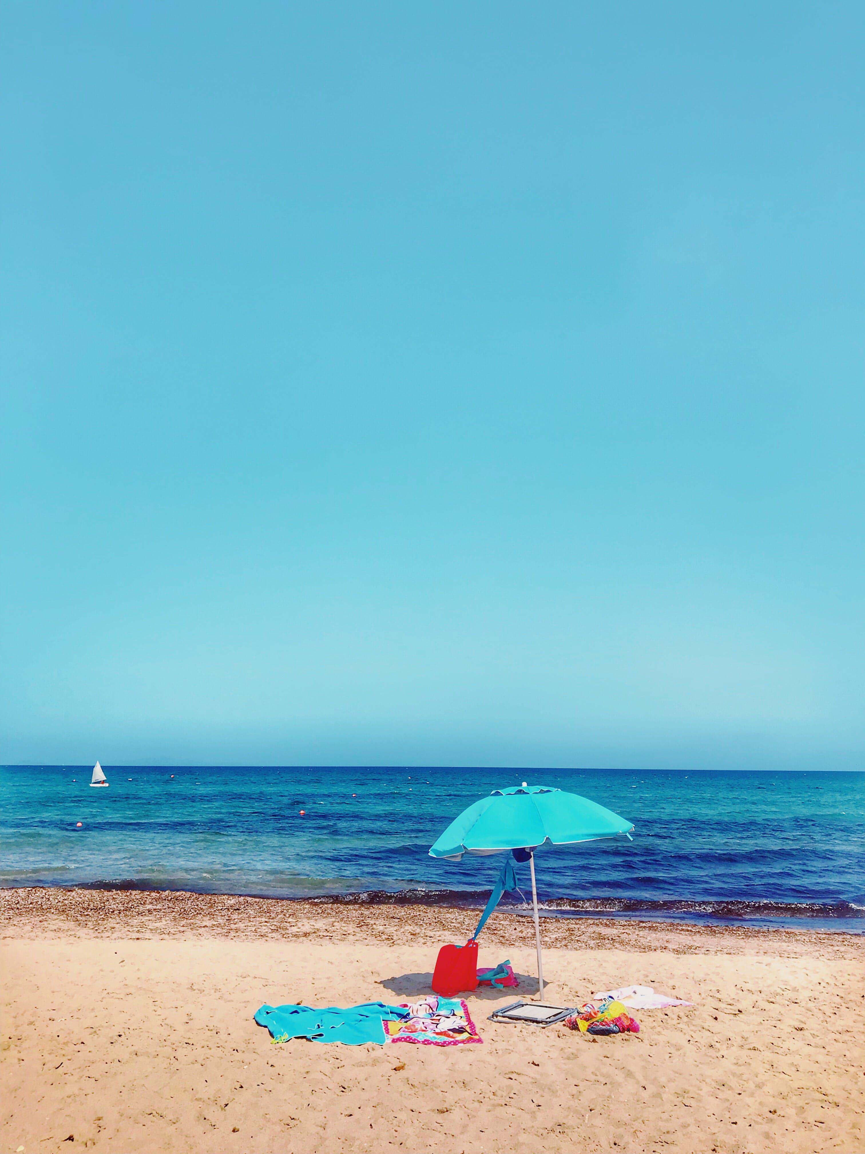 Teal Parasol At The Shore