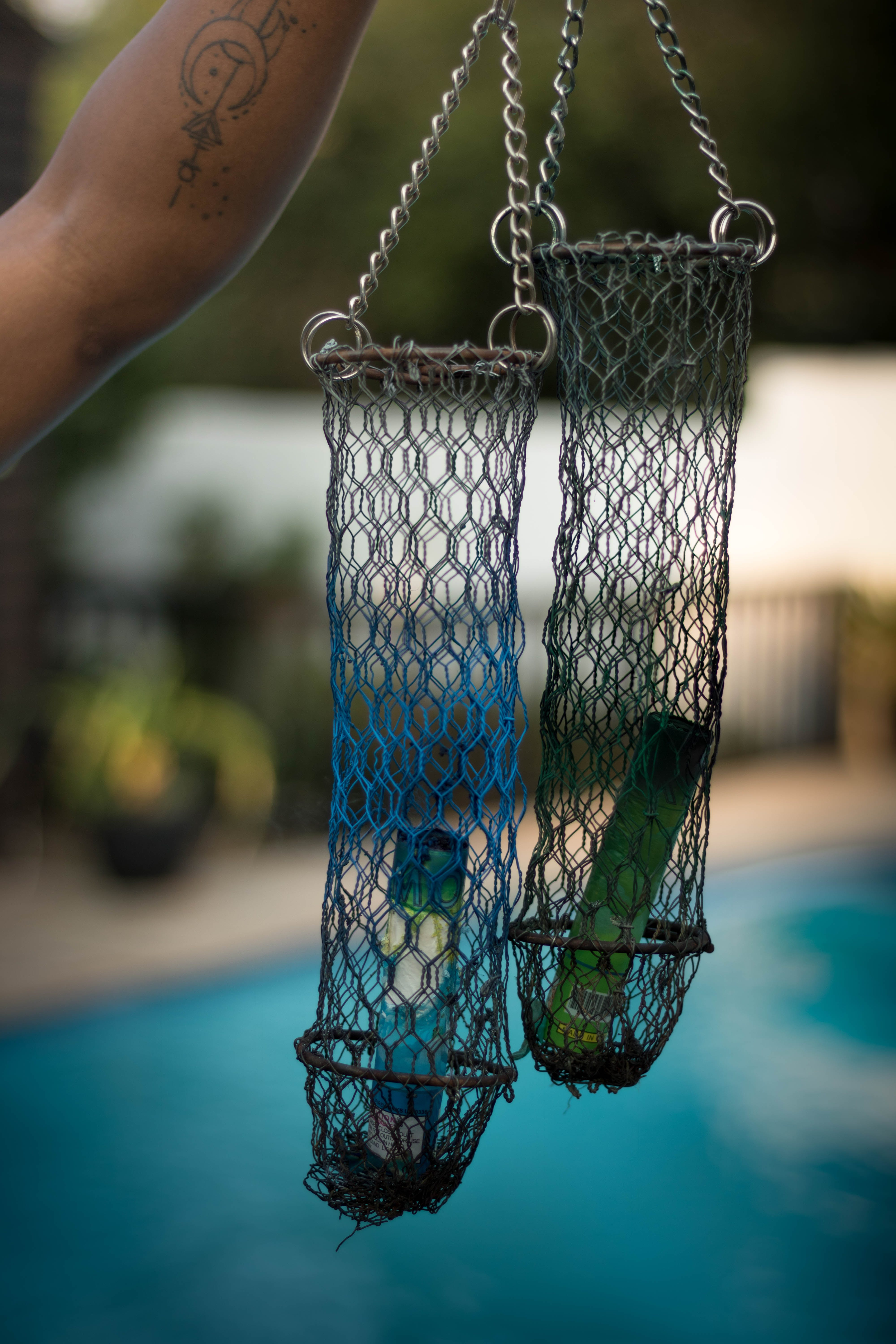 Person Holding Chain of Net Hanging Decors