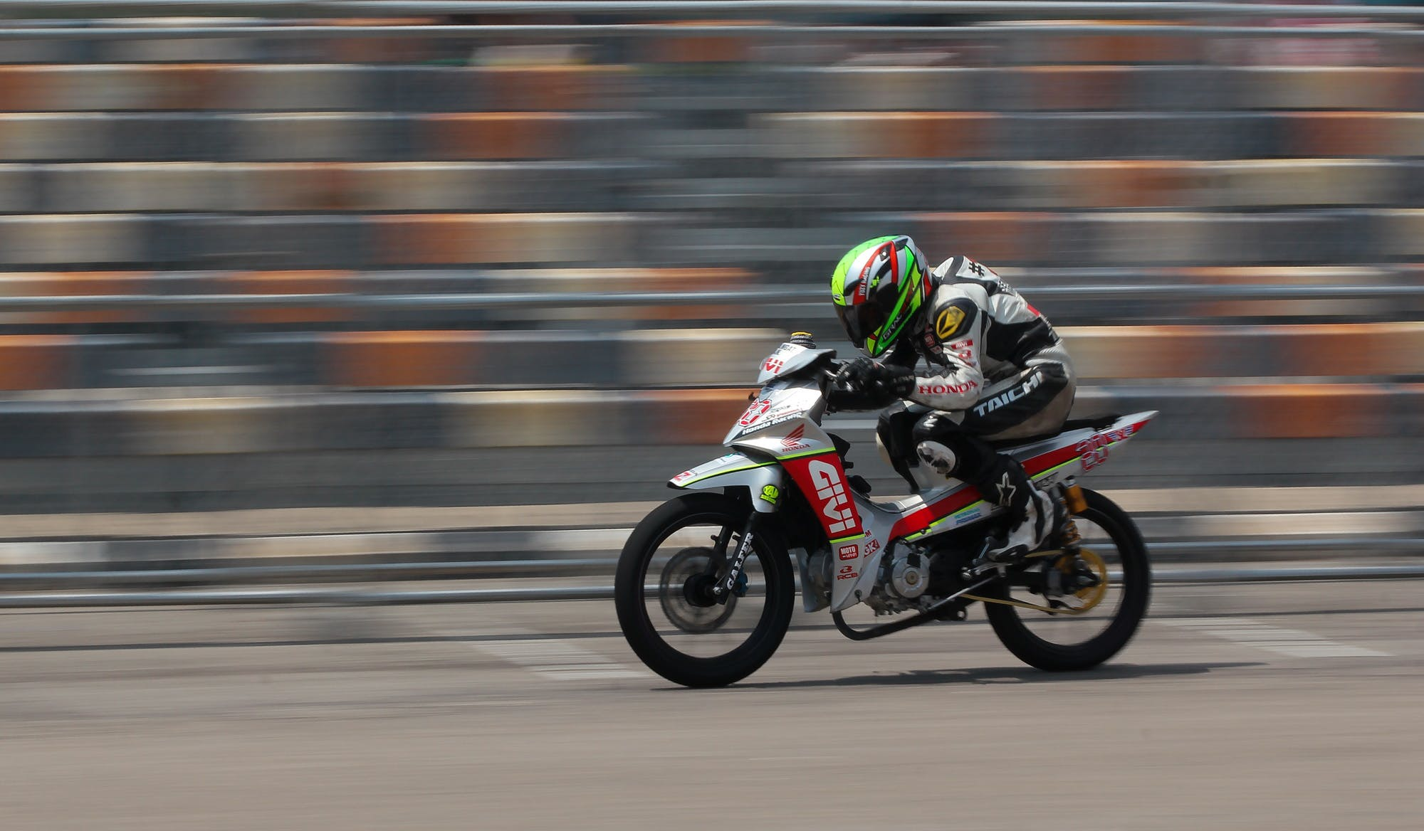 Motorcycle Racer on Silver Motorcycle