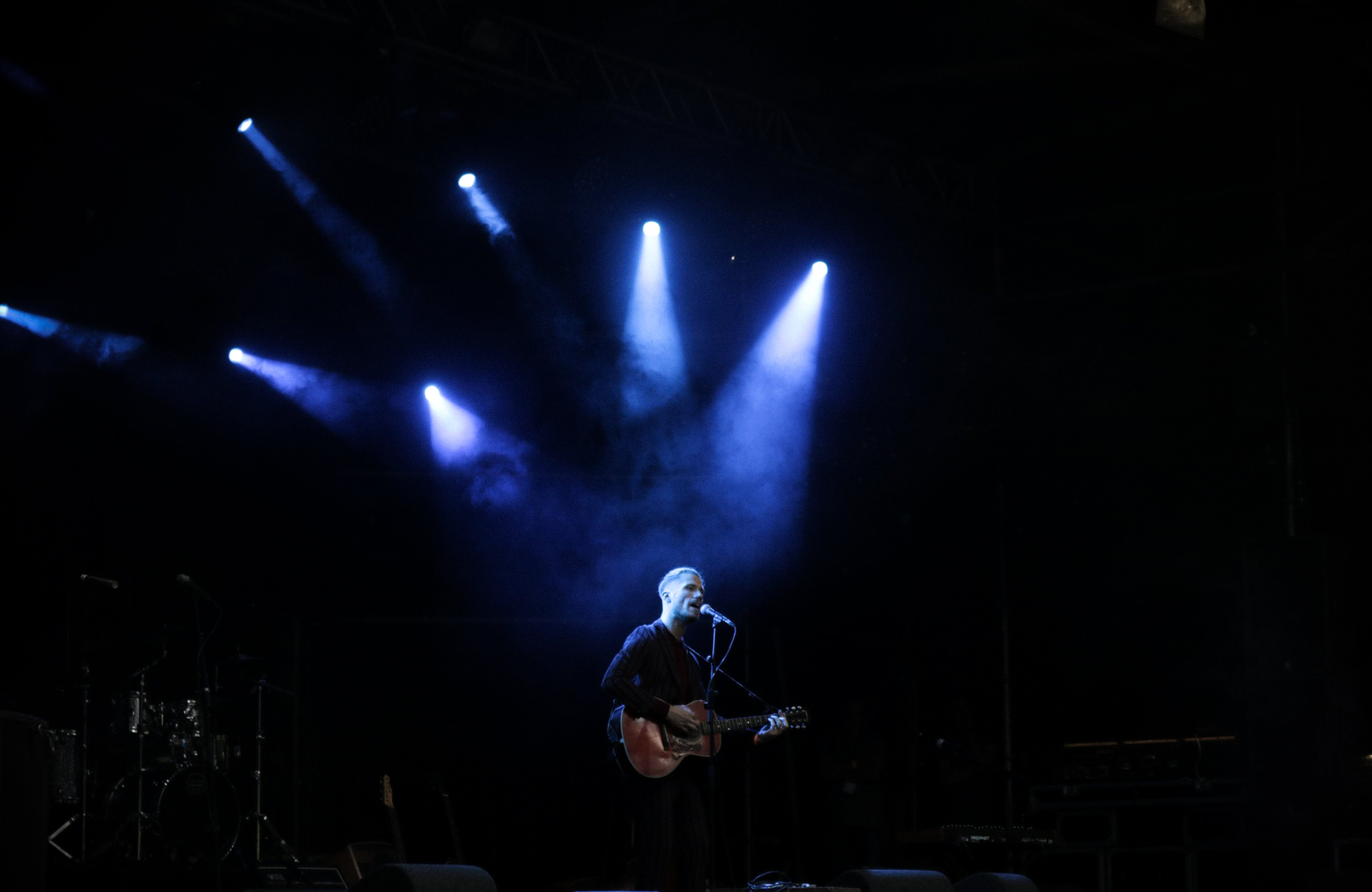 Person Performing With Guitar