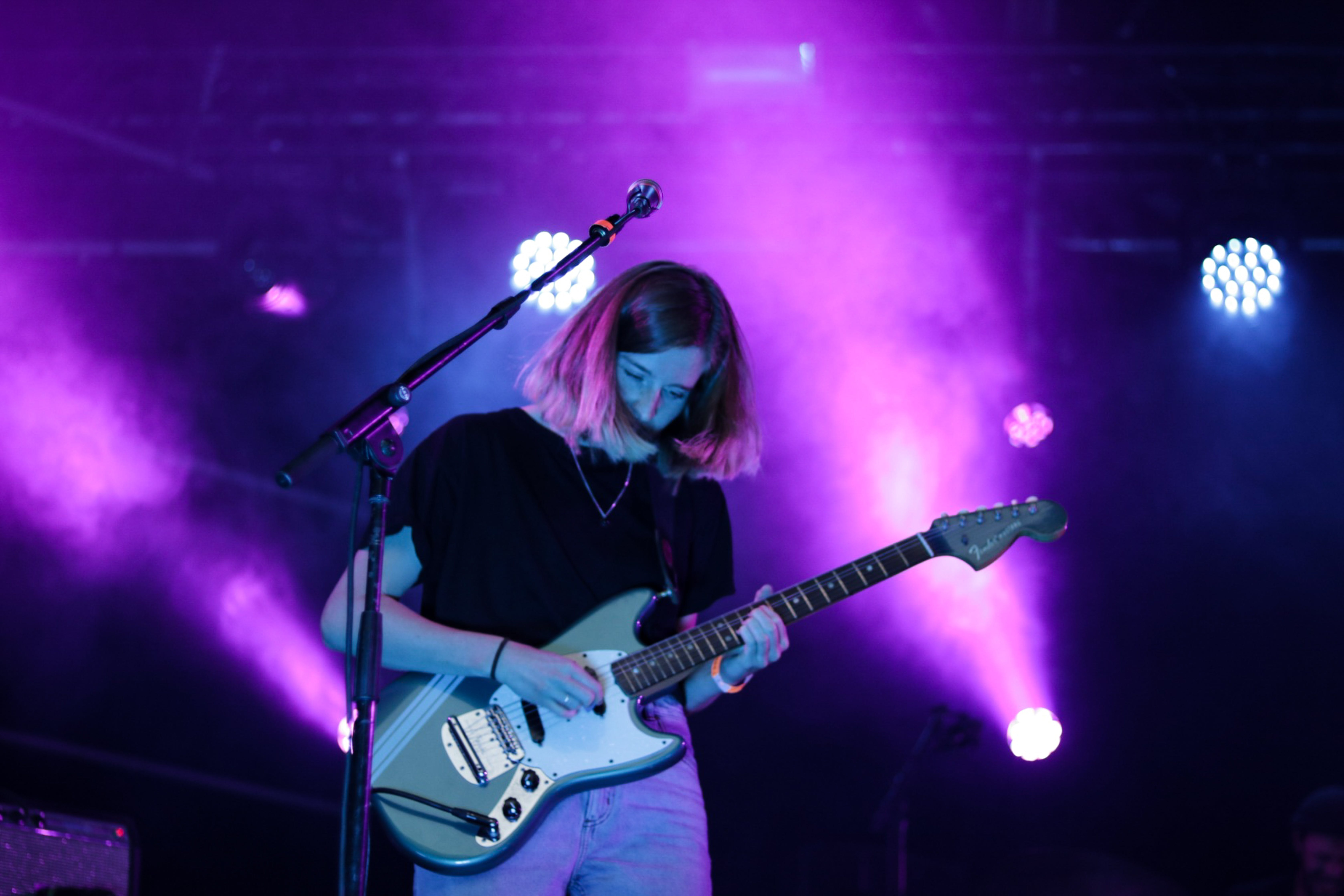 Photo Of Female Guitarist Performing On Stage