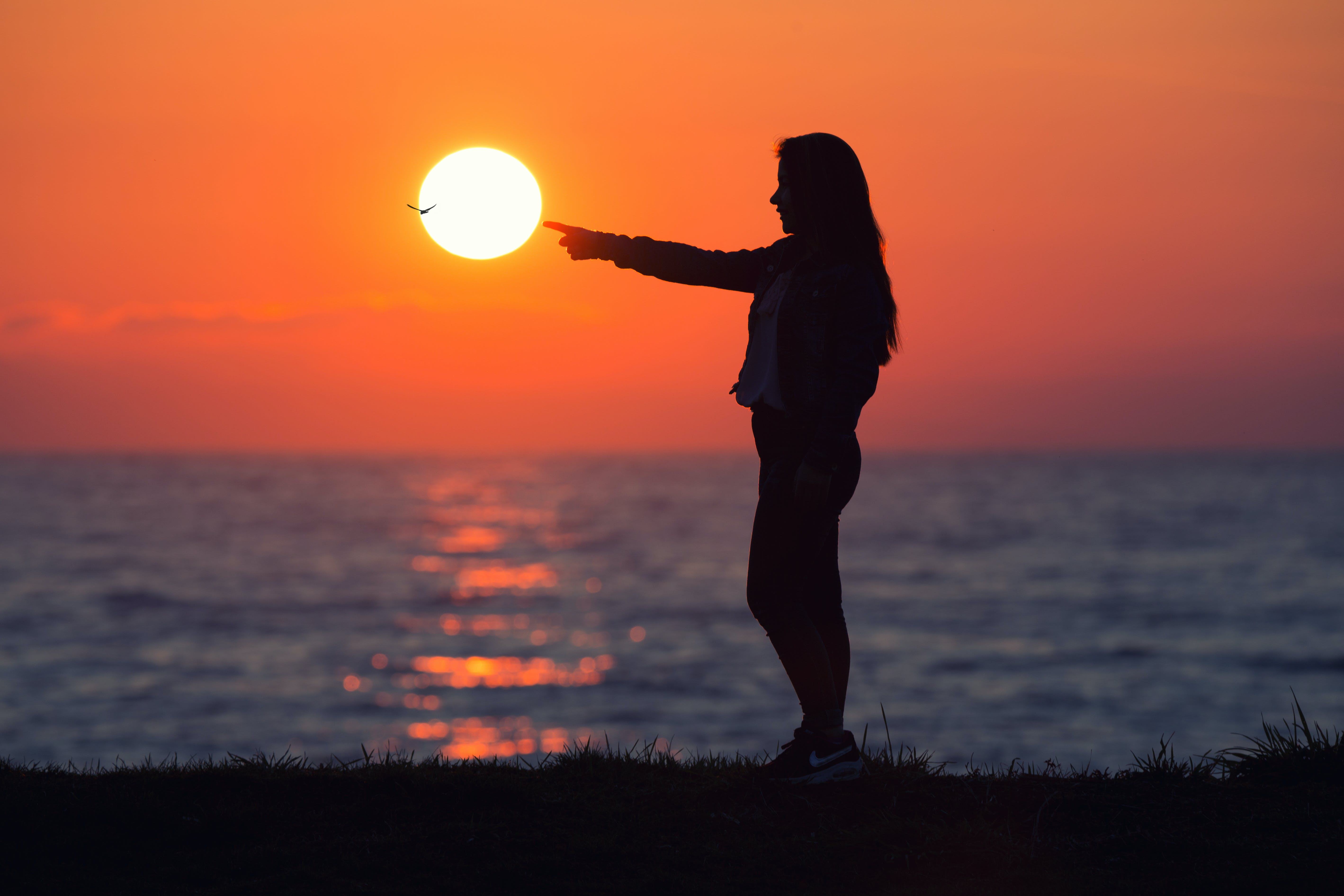 Woman Across Sun during Dawn