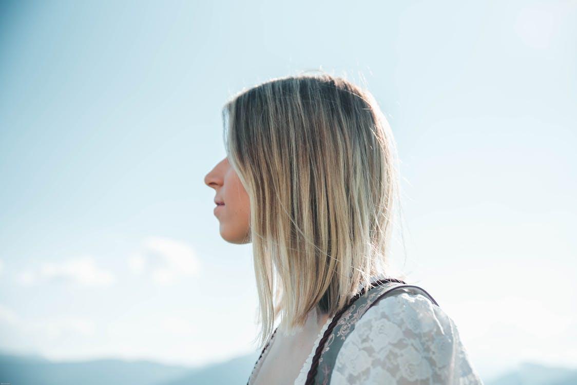Woman Wearing White Lace Top