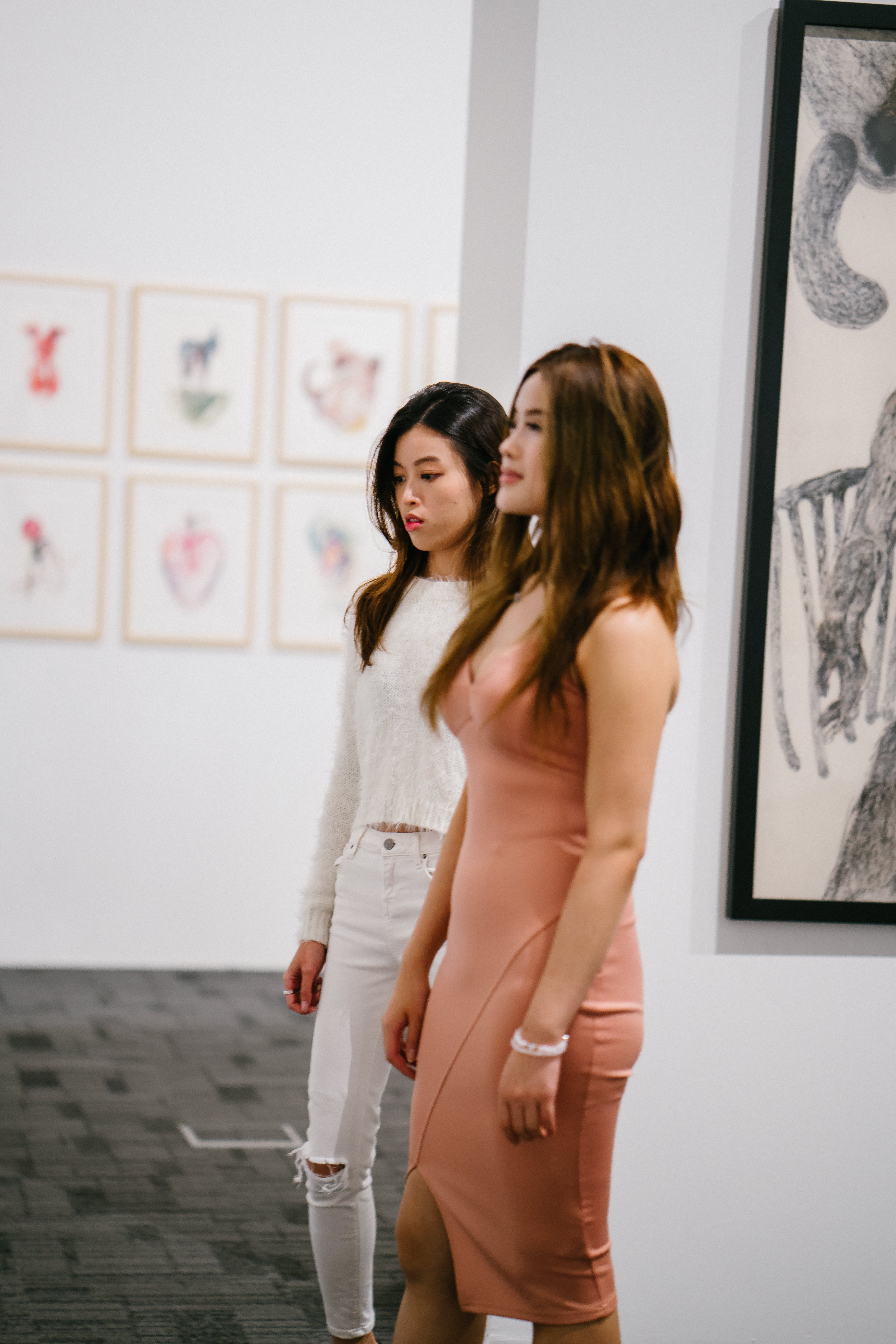 Two Women Standing Inside Museum