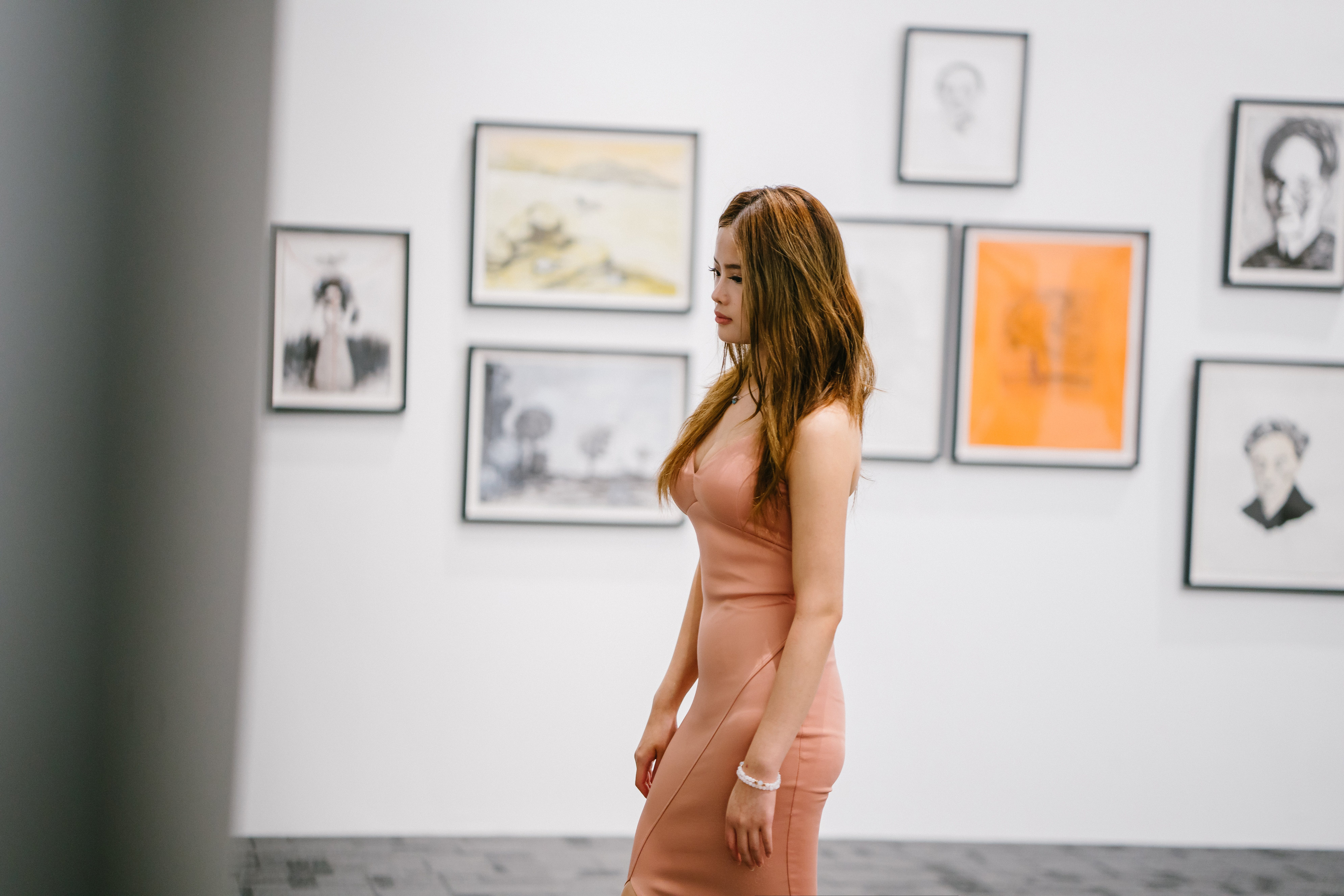 Woman Standing Near Paintings On Wall