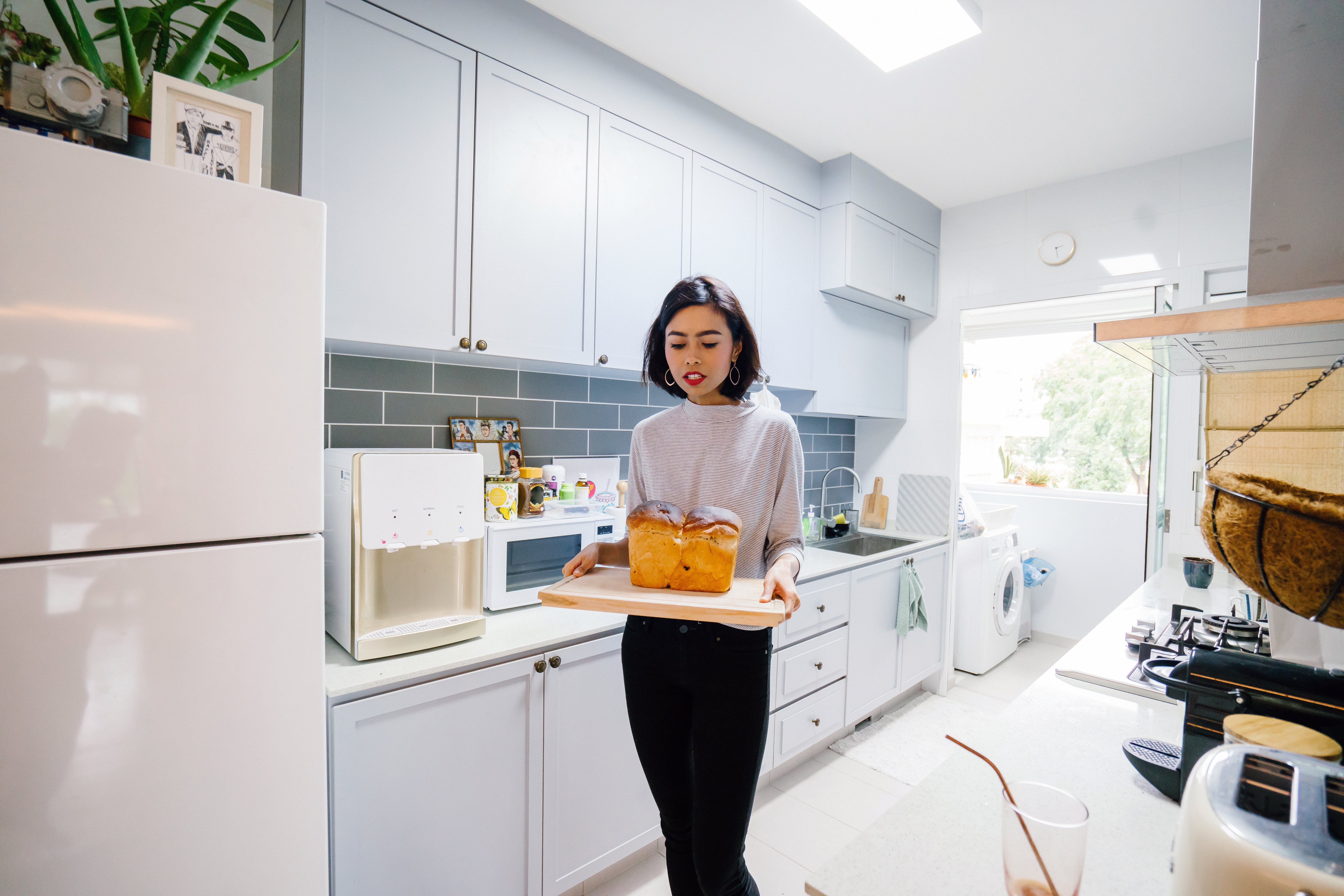 Woman Standing Holding Chopping Board