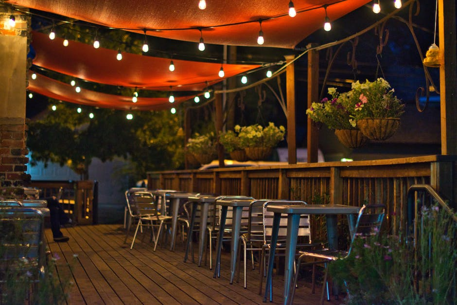 String lights over dining patio at night