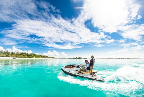 Two People Riding A Jet Ski