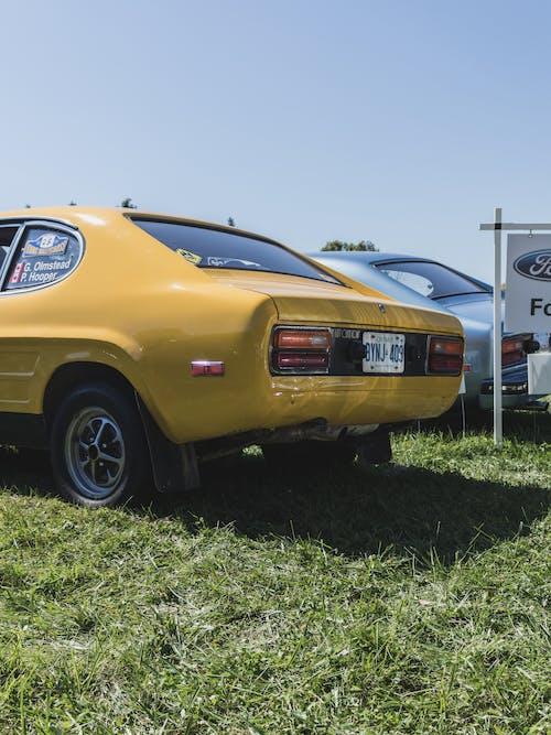 Foto profissional grátis de amarelo, automóvel