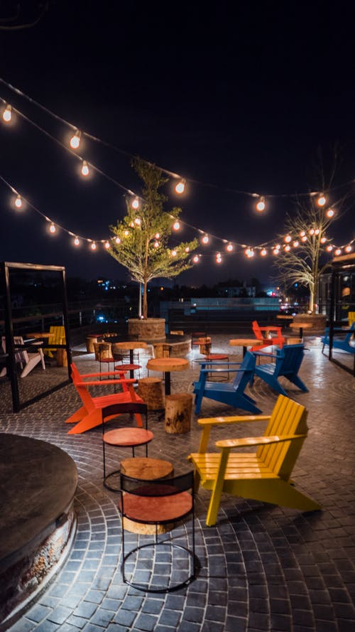 Free stock photo of bar, colored chairs, night, night lights