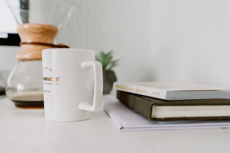 White Mug Near Book