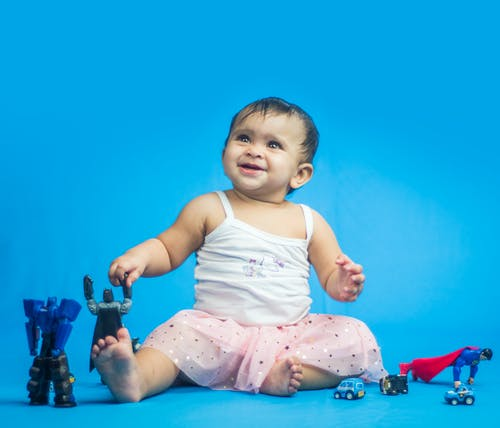 Free stock photo of blue background, cute, cute baby, laughing