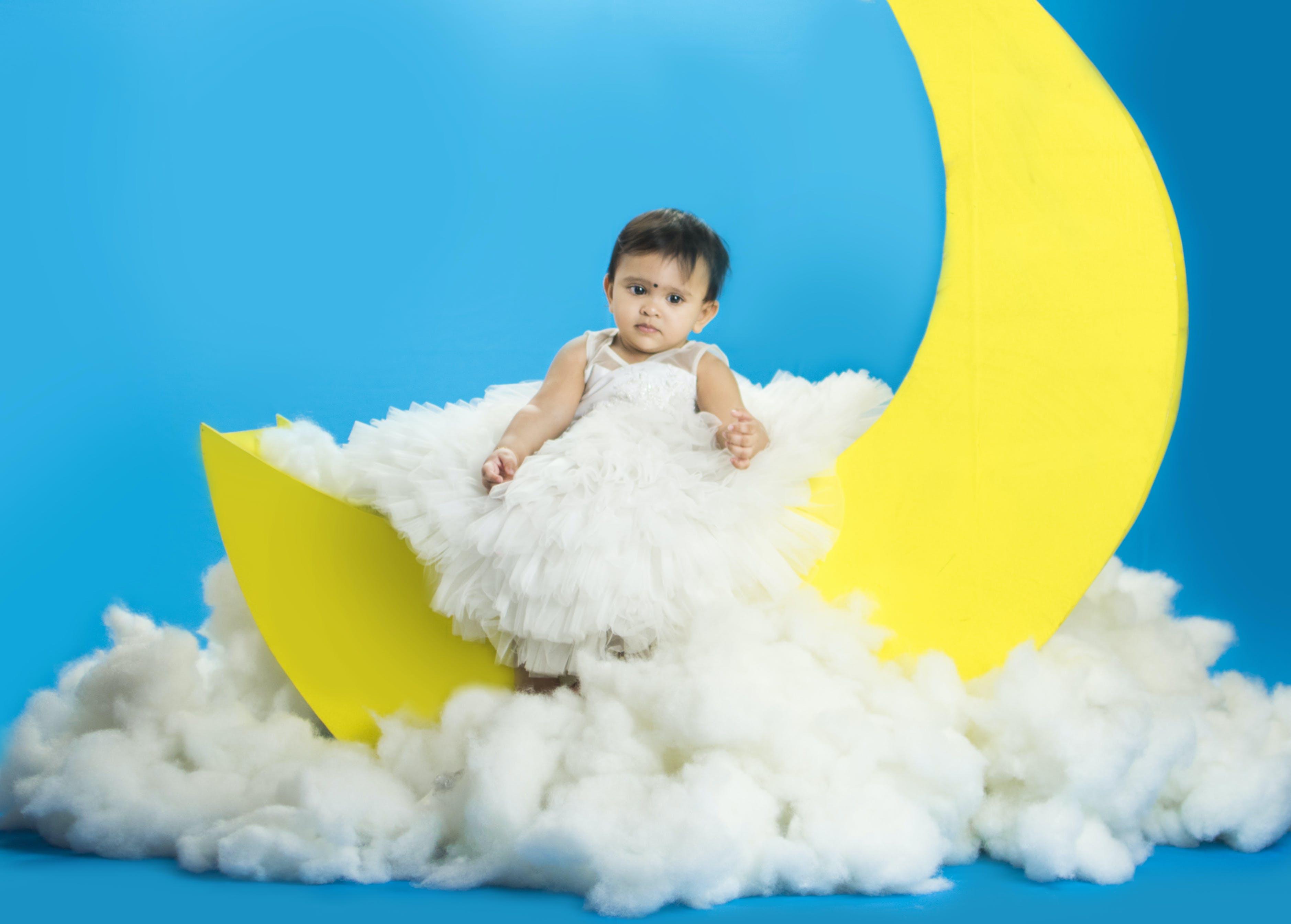 Free stock photo of baby, baby sitting, blue yellow, clowds