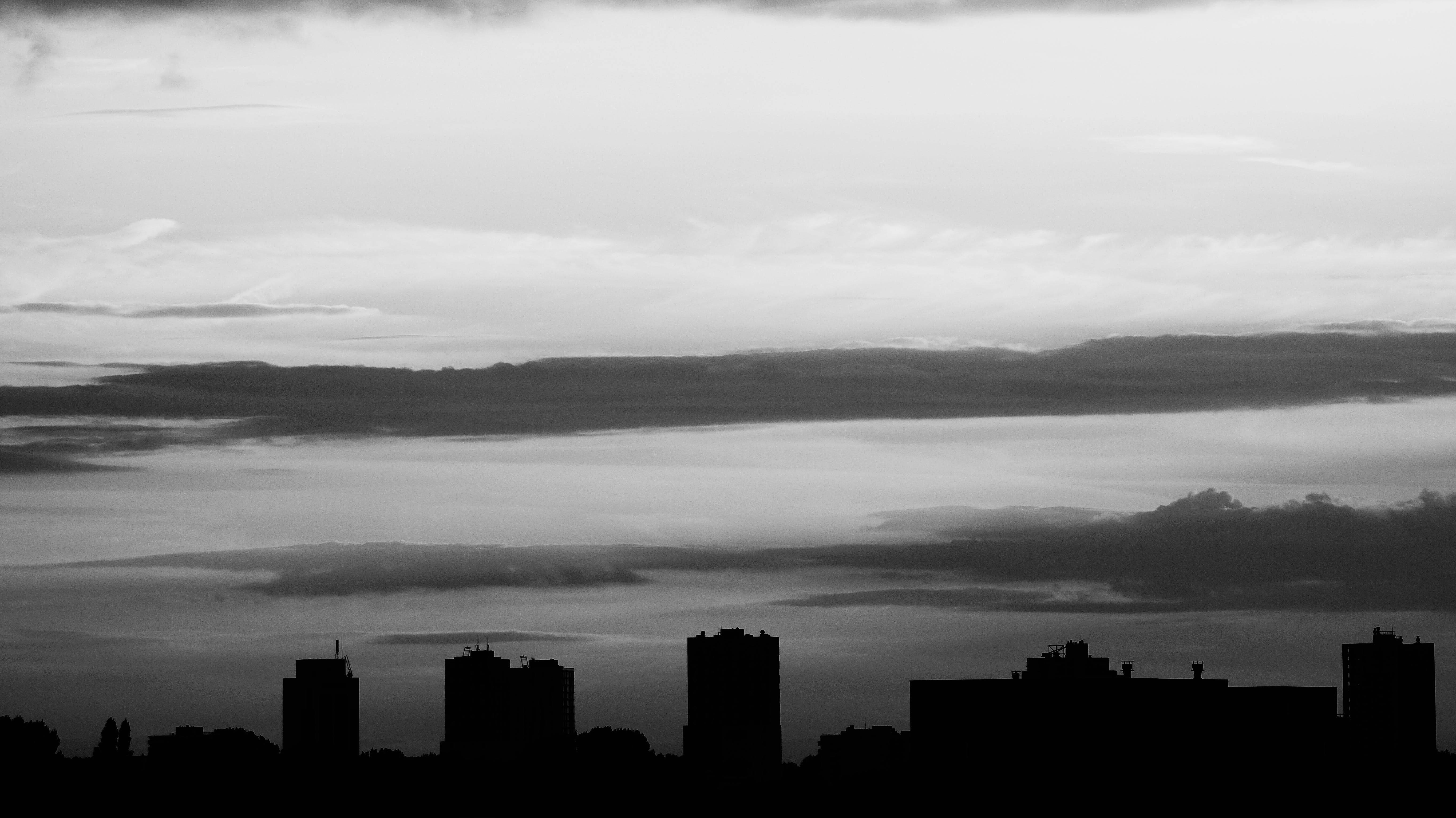 Silhouette of Buildings Under Gray Clouds