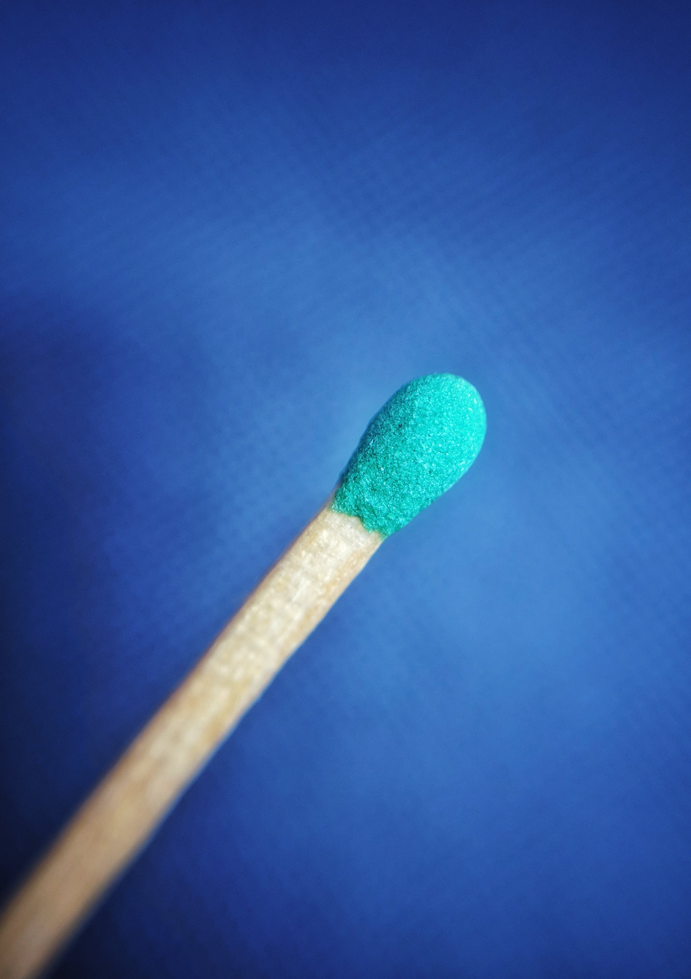 Close Up Photo of Green Matchstick