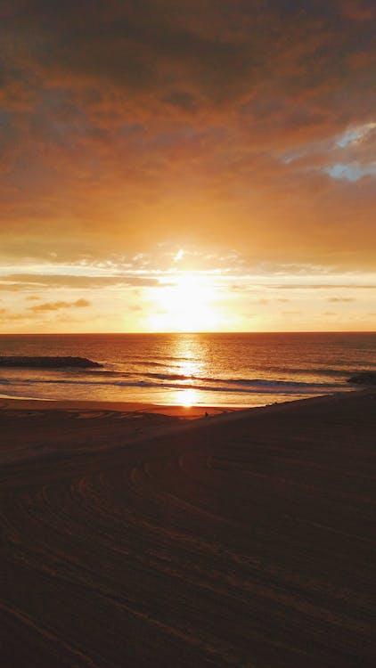 Gratis lagerfoto af kystbane, morgensol, solopgang