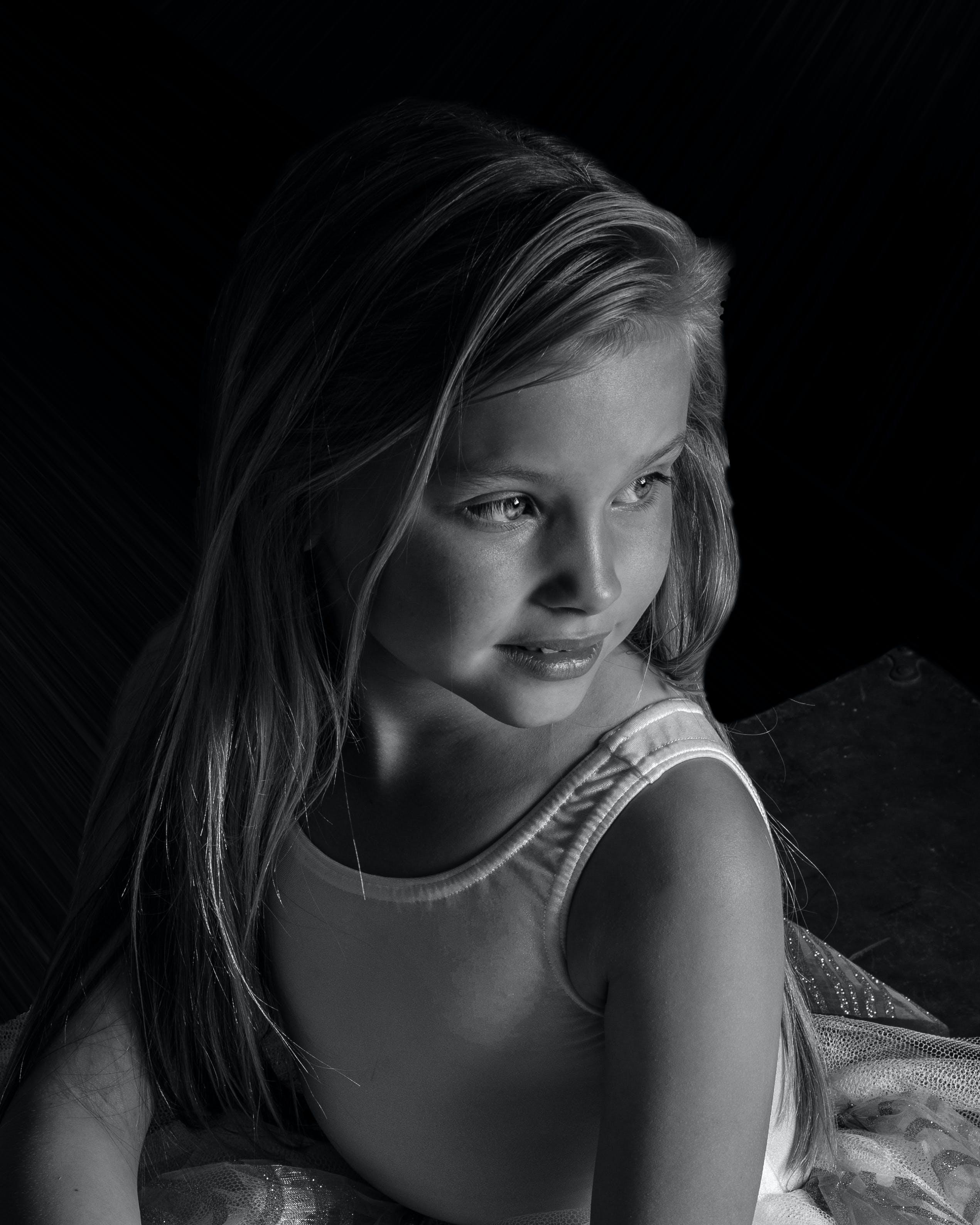 Grayscale Photo of Girl Wearing Leotard