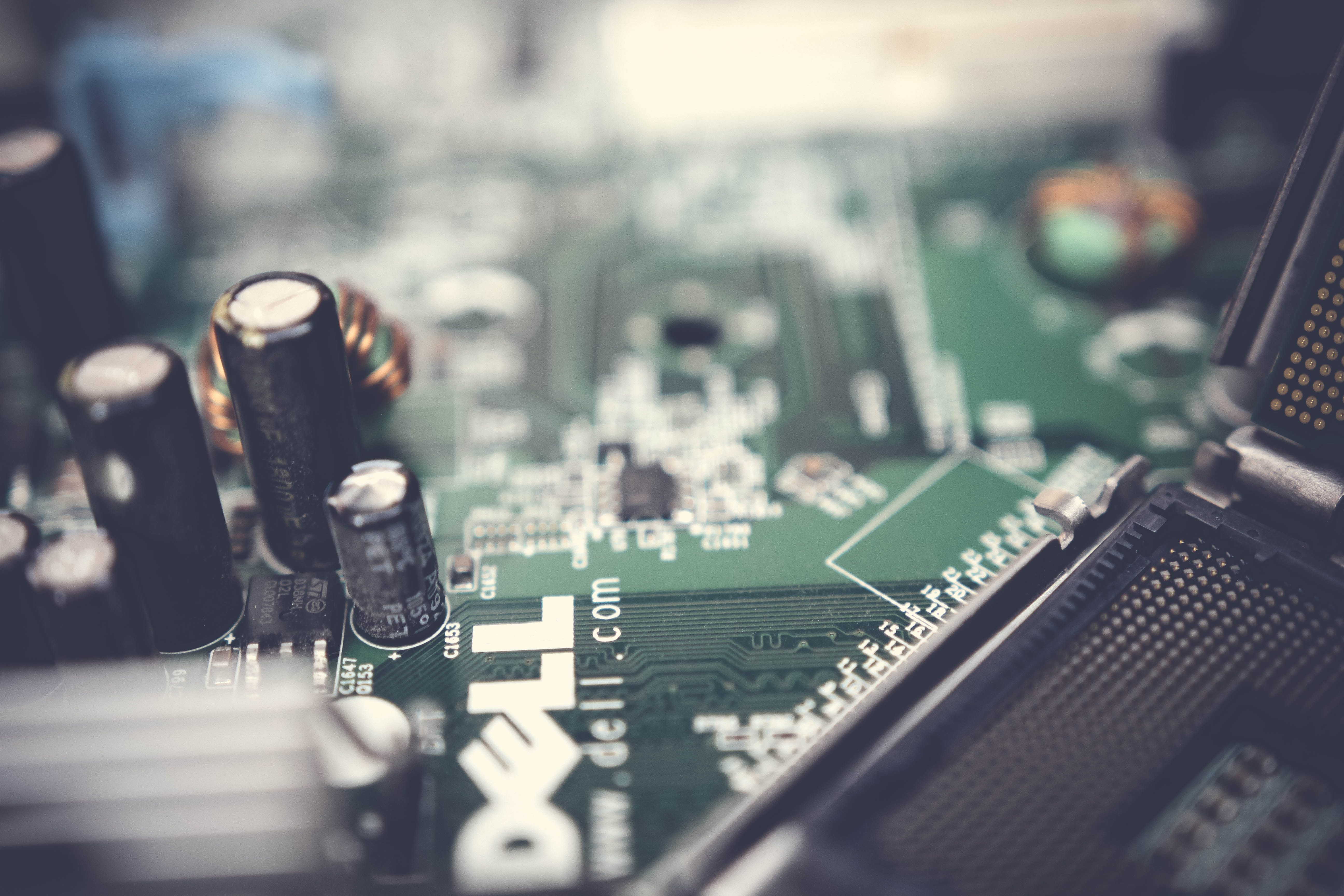 Closed Up Photo of Green Dell Circuit Board