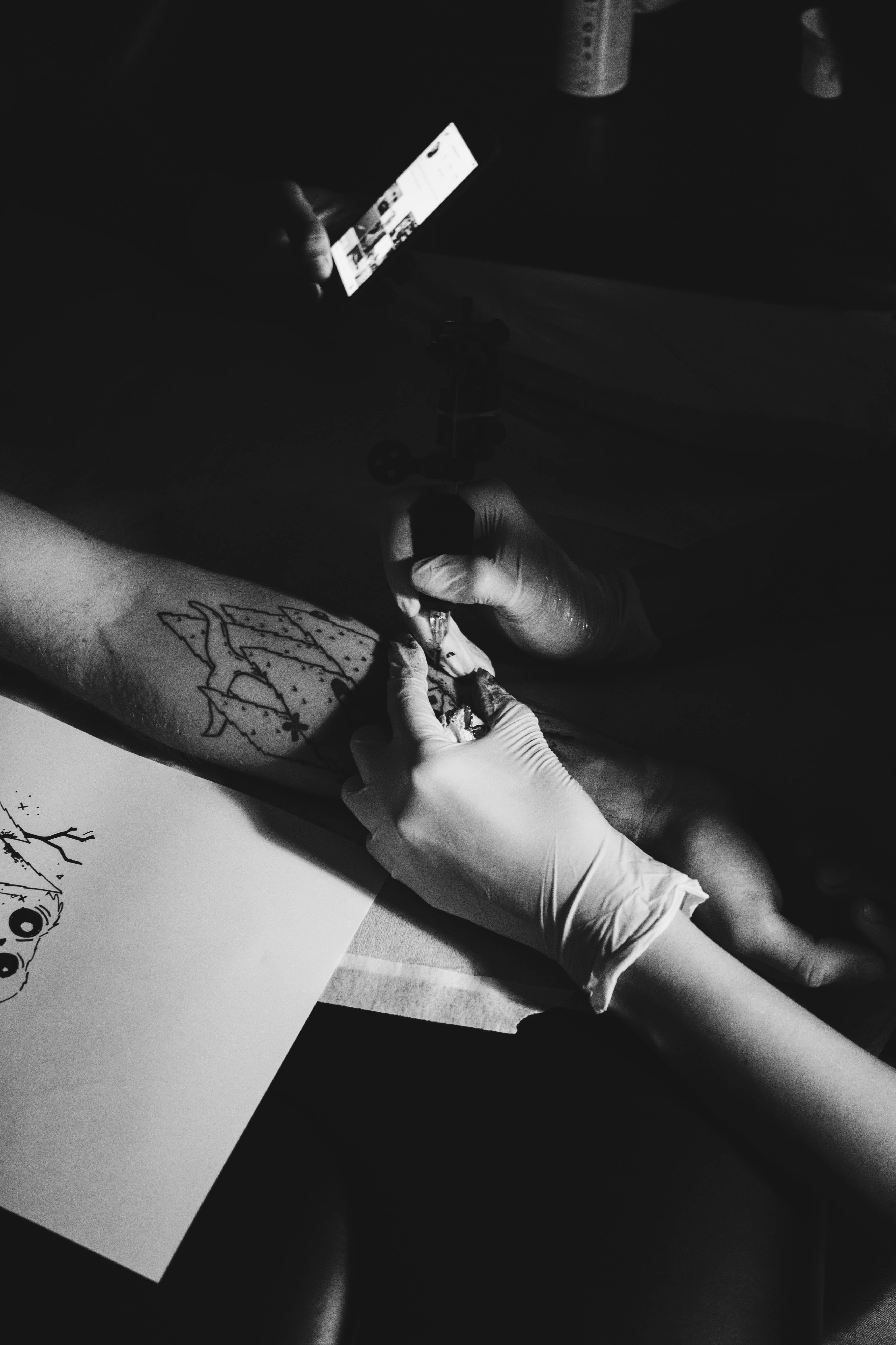 Person Doing Tattoo Session