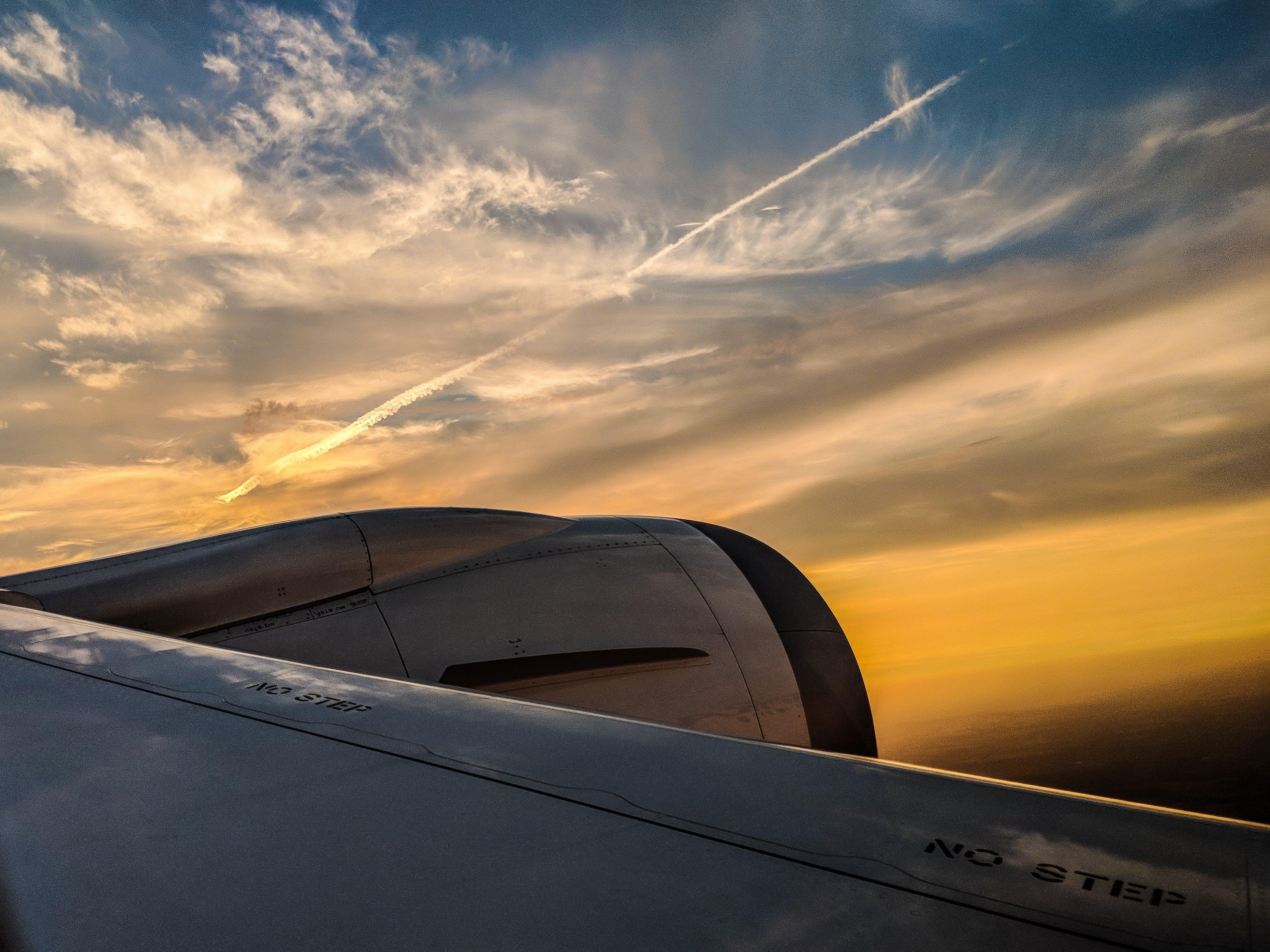 White Airliner in Flight Against Sky