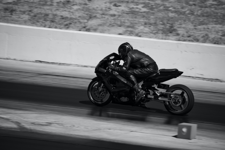 Photo of Person Riding a Black Sports Bike