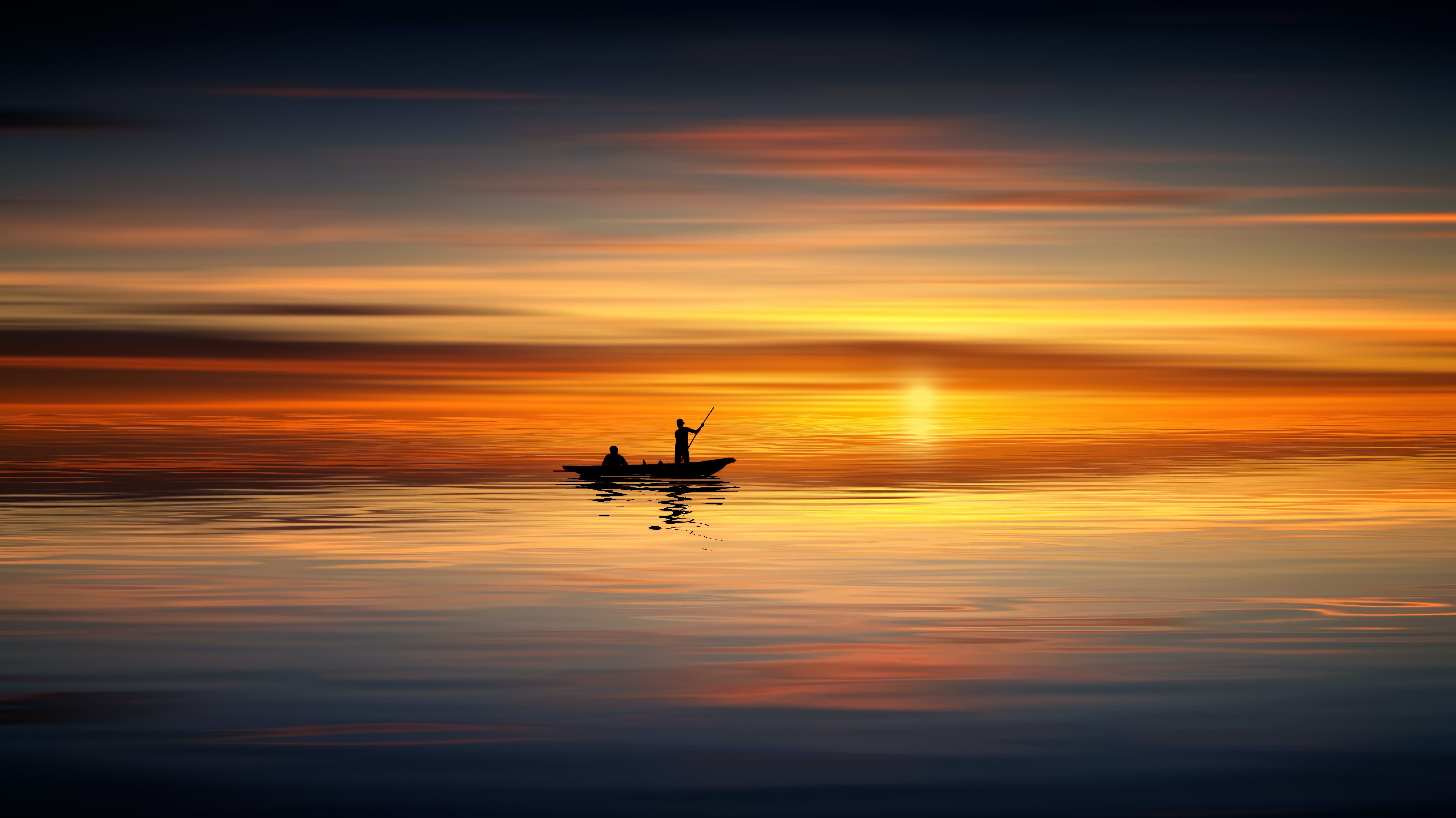 Photo of People on Rowboat During Sunset