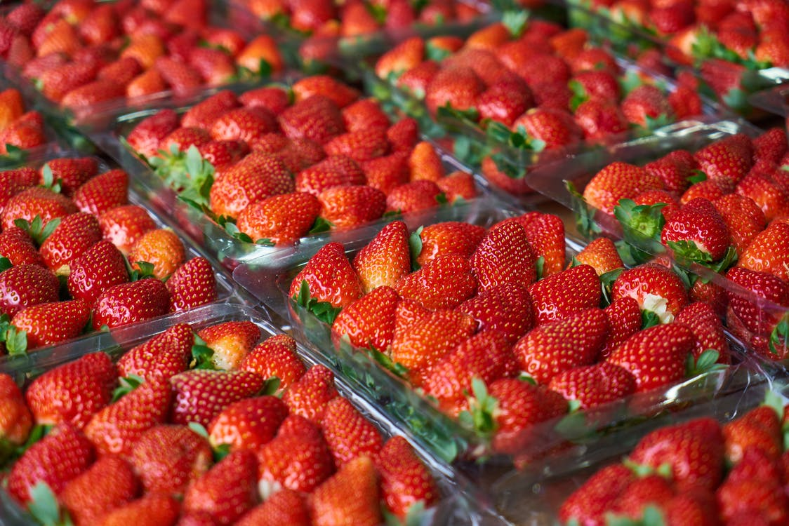 Close-Up Photo of Strawberries on Plastic Container