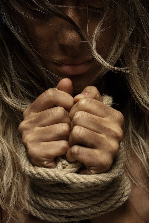 Close-Up Photo of Woman With Her Hands Tied With Rope