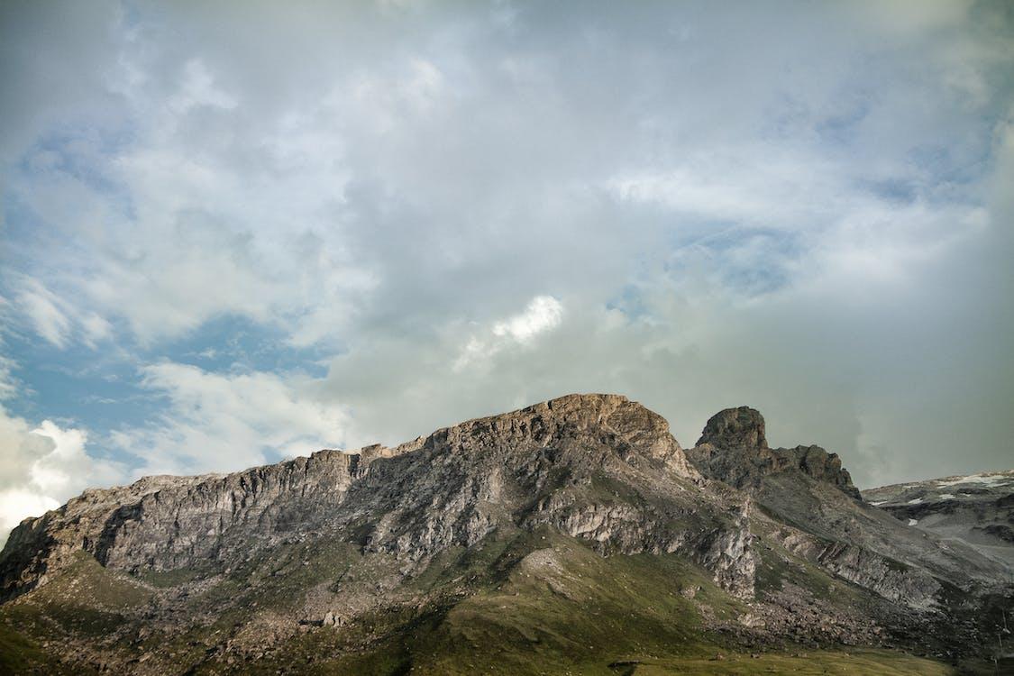 Grey Mountain Under Cloudy Sky