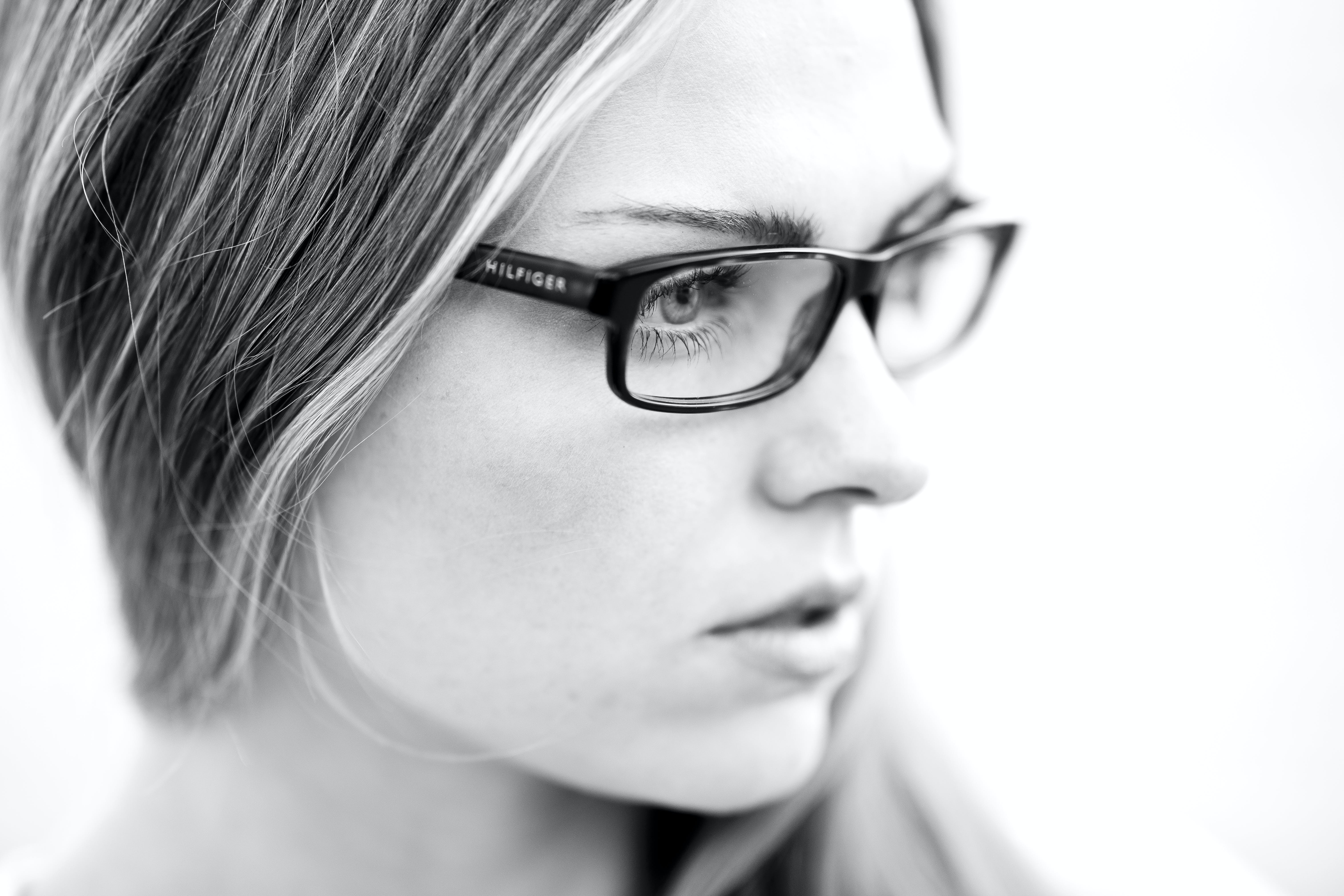 Grayscale Photography of Woman Wearing Eyeglasses