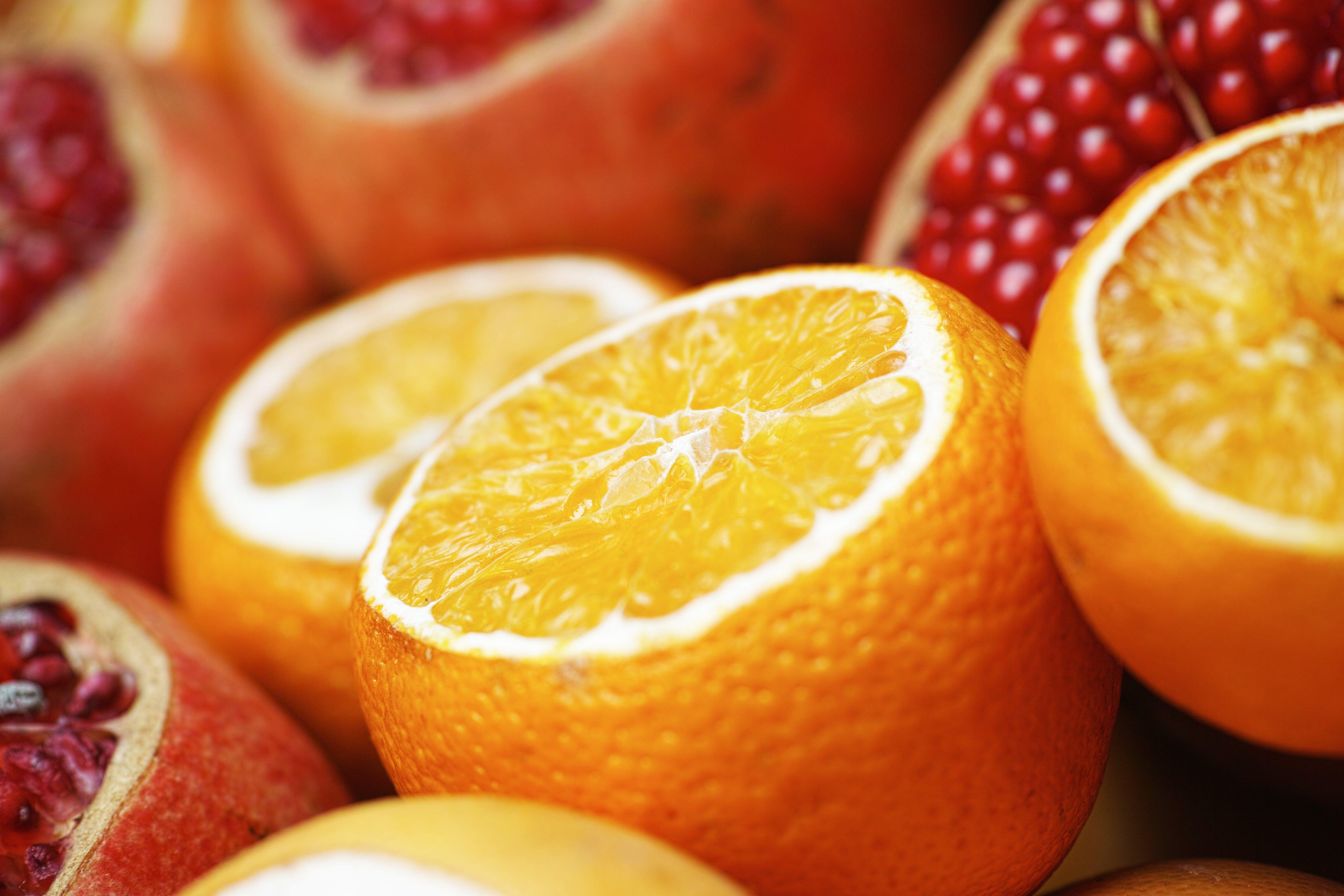 Close-up Photo of Sliced Orange and Grapefruit Fruits