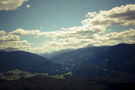 Black Mountain Range Under Gray Cloudy Sky during Daytime