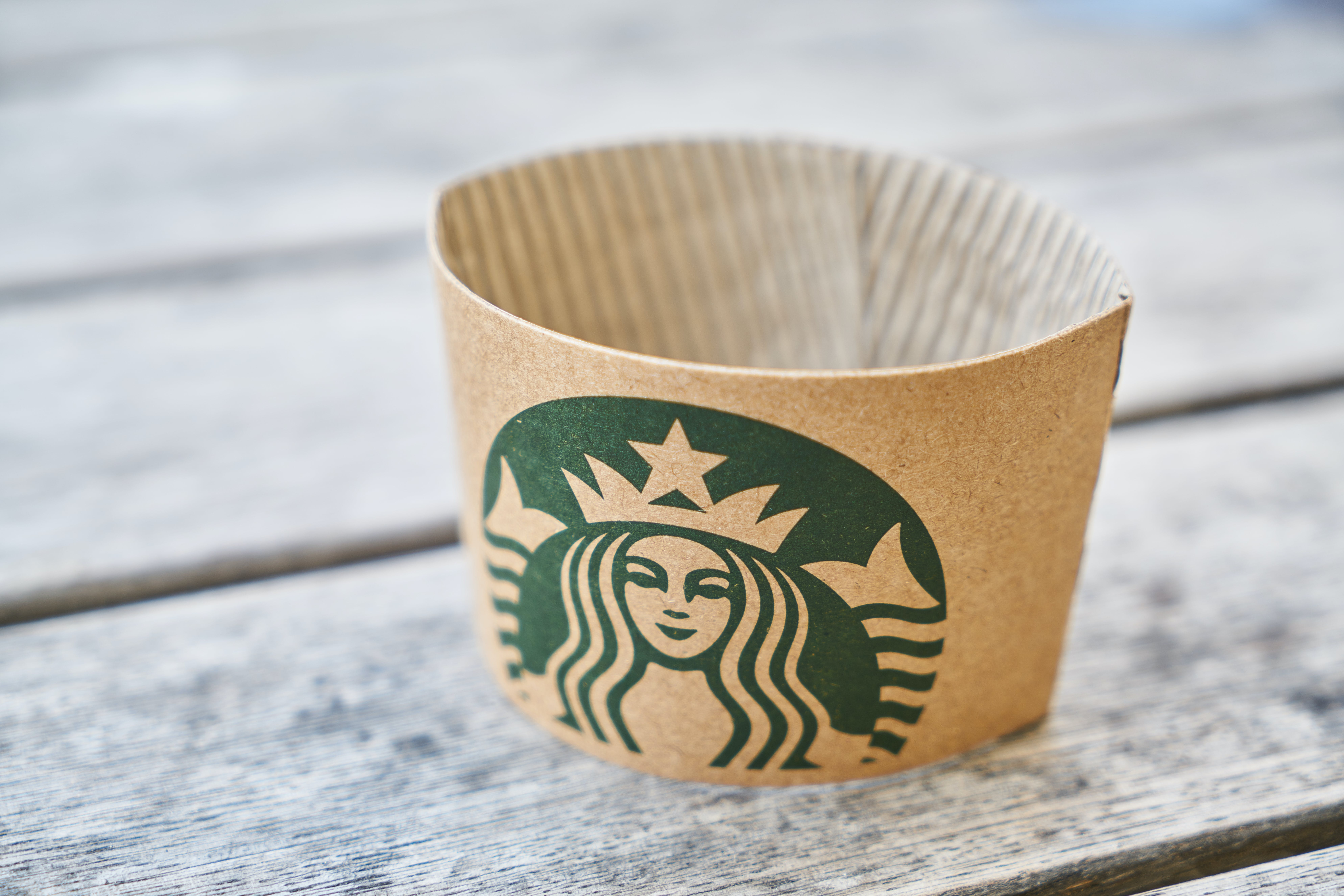 Brown Starbucks Paper on Gray Wooden Surface