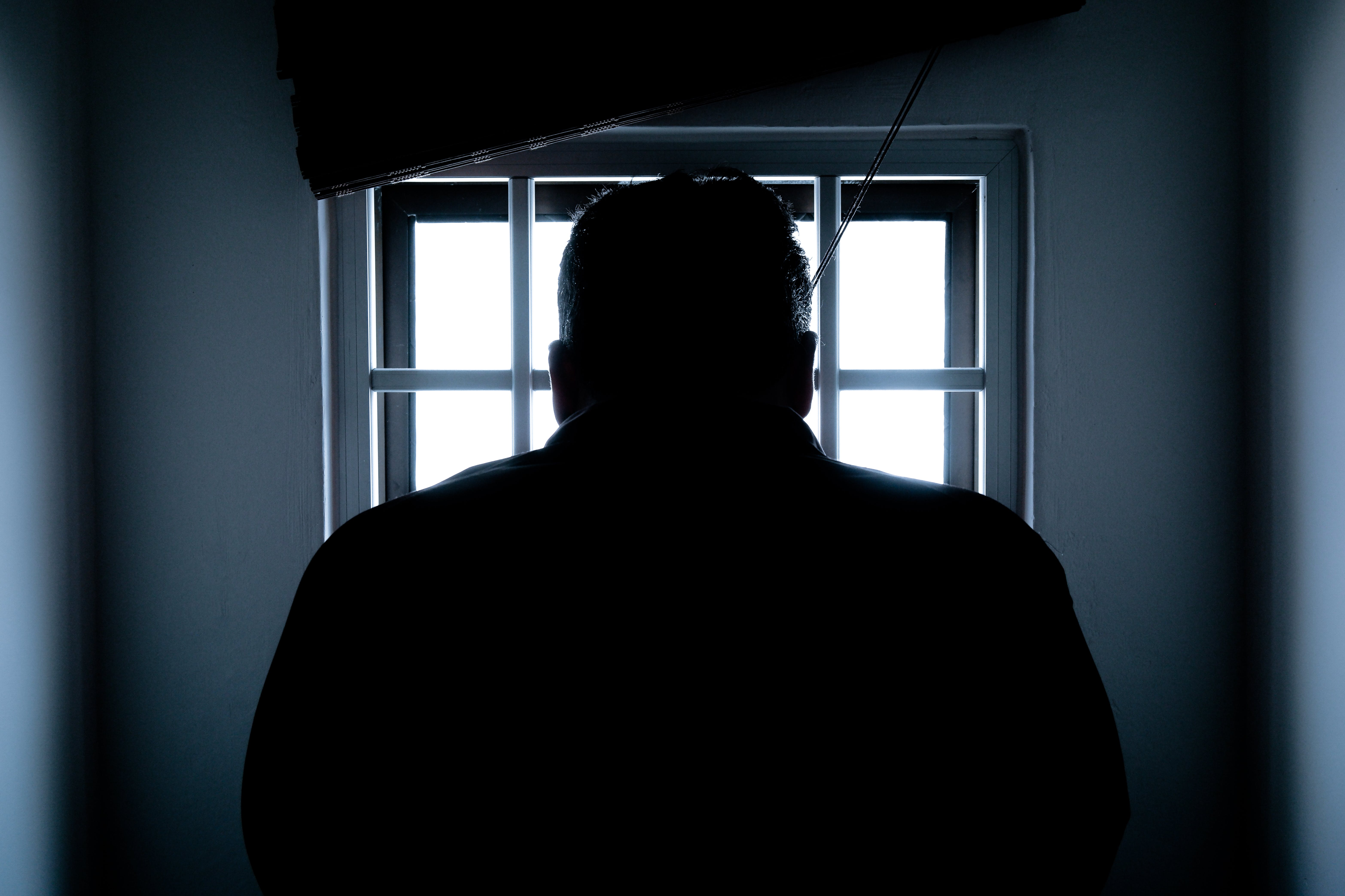 Rear View of a Silhouette Man in Window