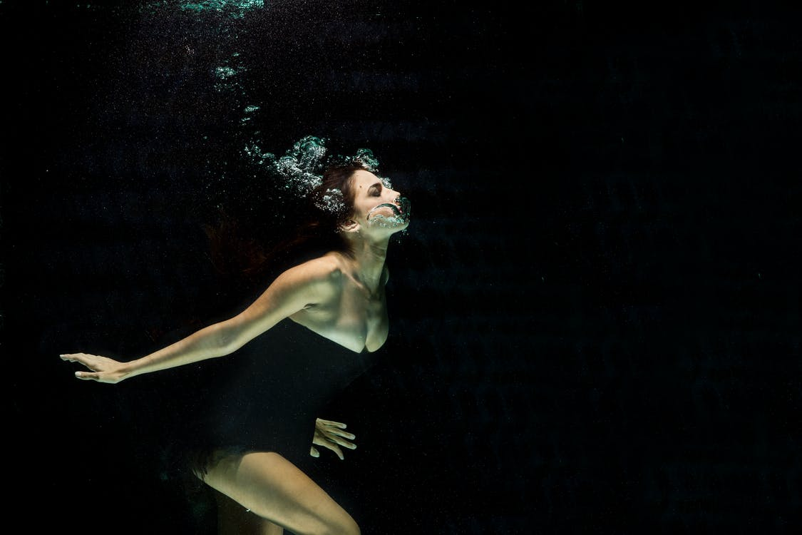 Woman Wearing Black Dress Under Water Photography
