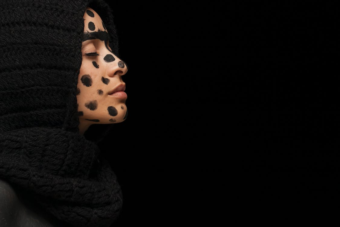 Woman With Black Dots on Face