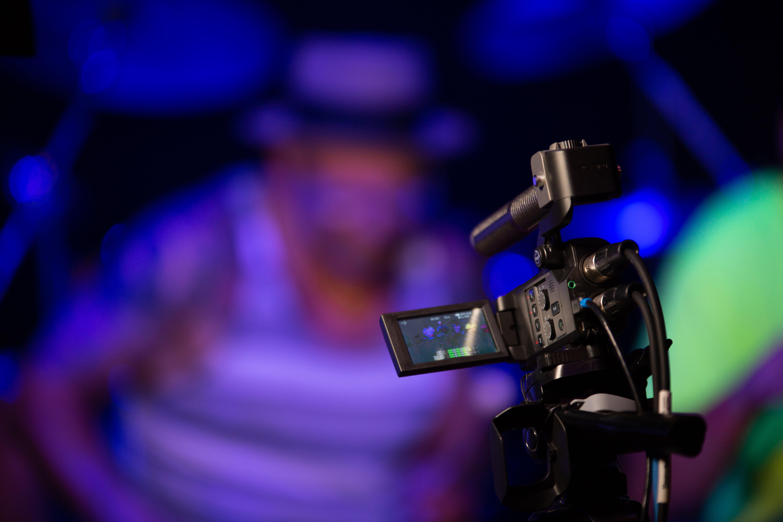 Black Video Camera Near Person