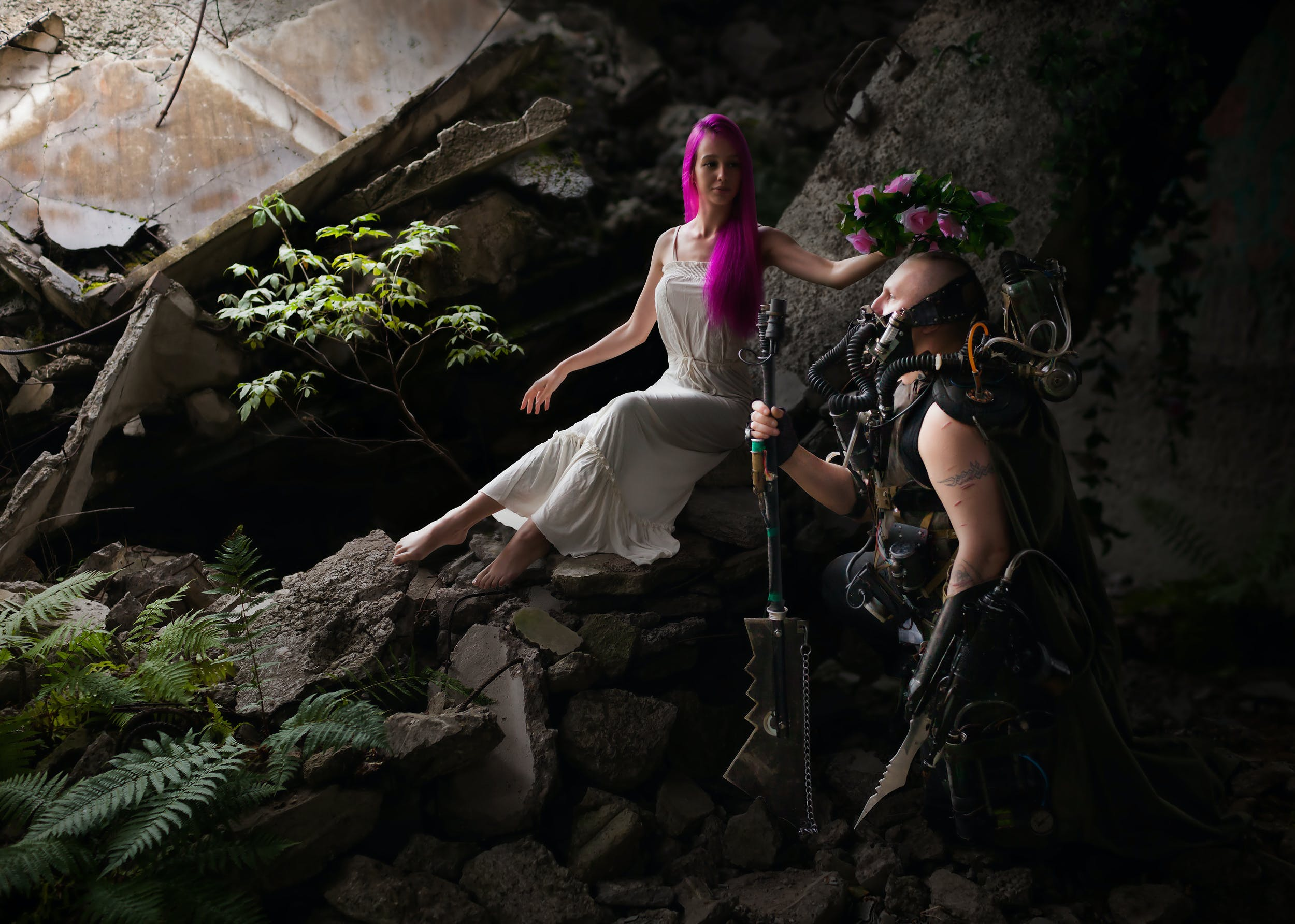 Woman With Purple Hair Wearing White Sleeveless Dress Sitting on the Rocks Holding Pink Floral Headband