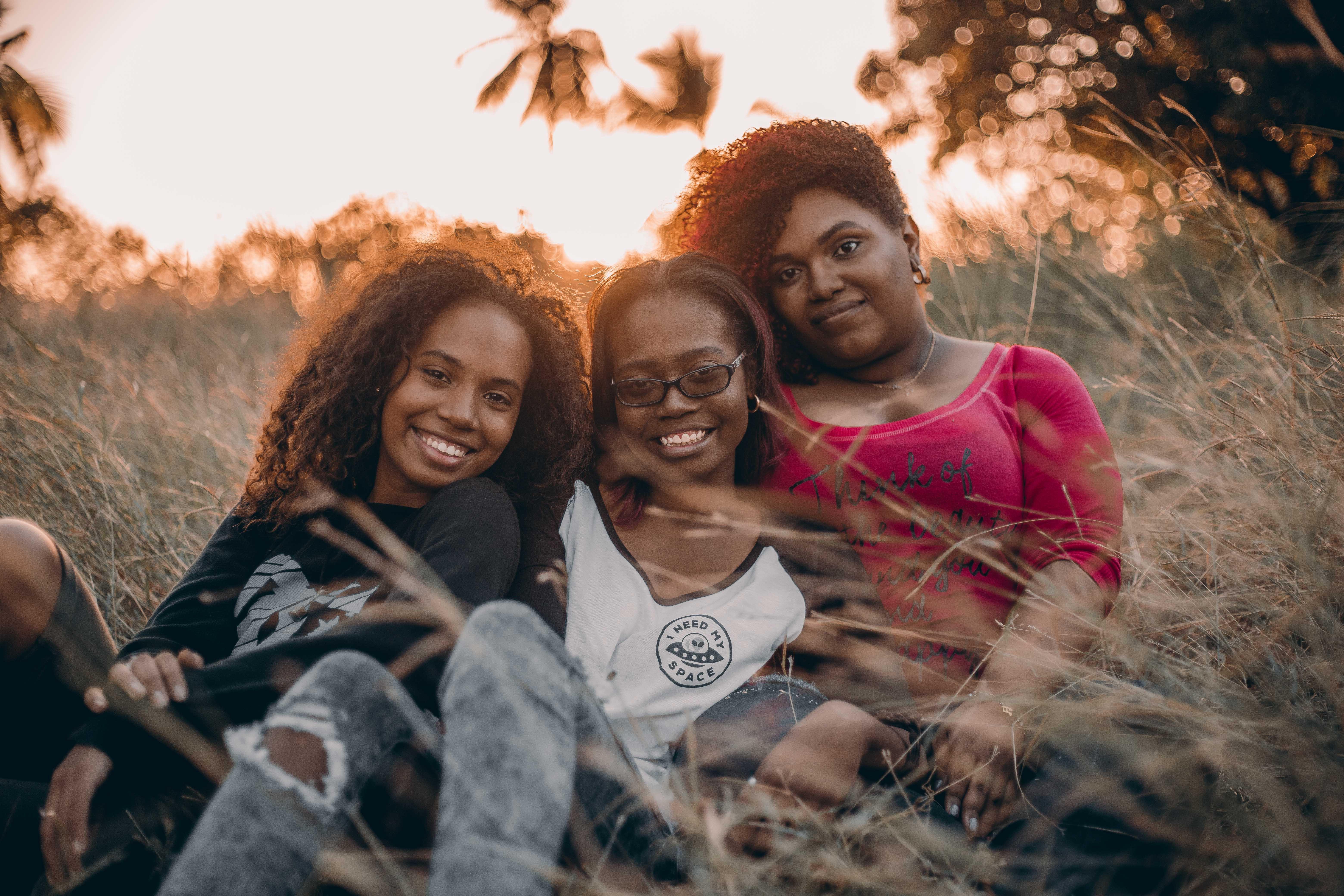 Three Women Sitting on Grass