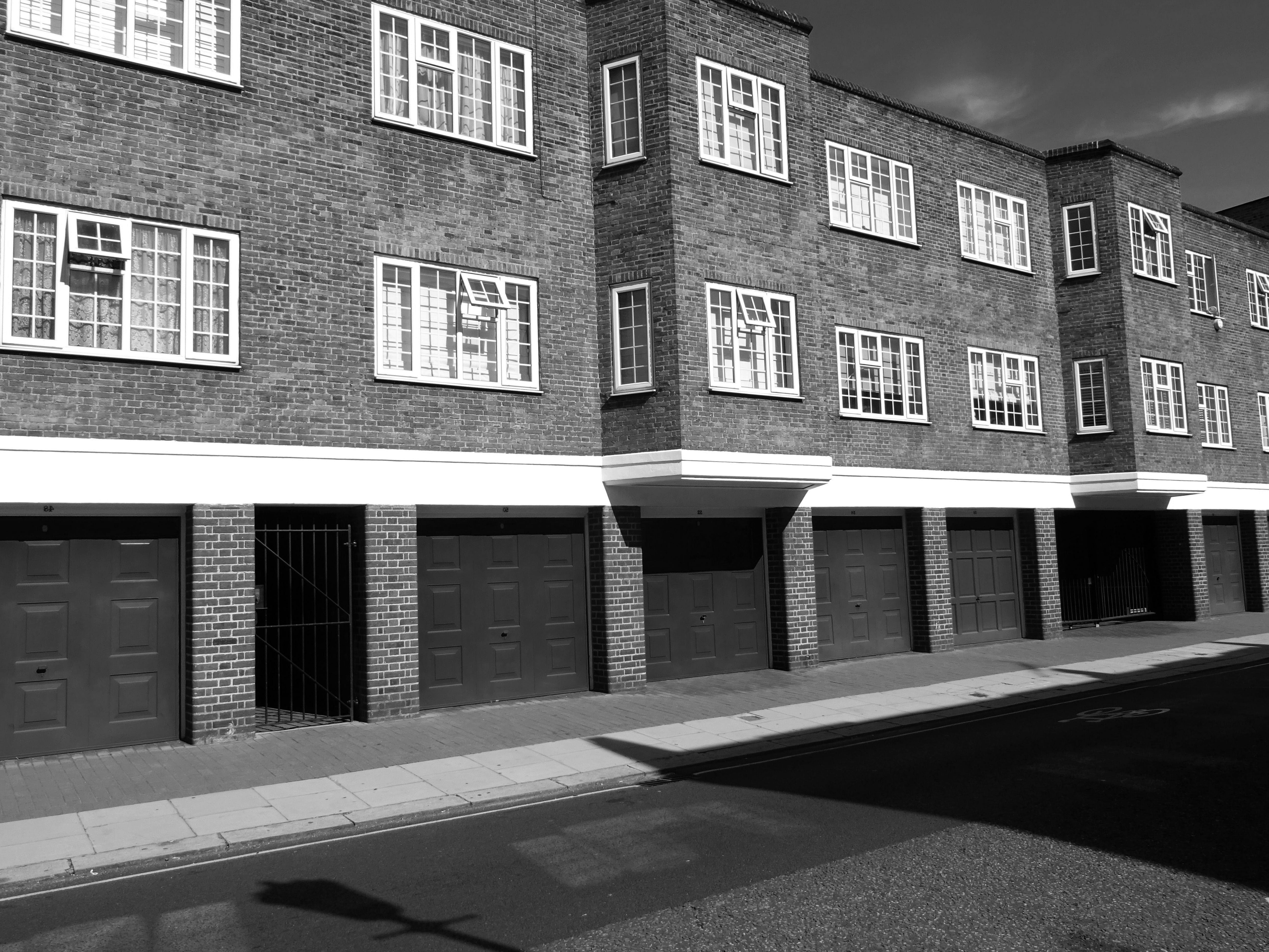 Grayscale Photo of 2-storey Building