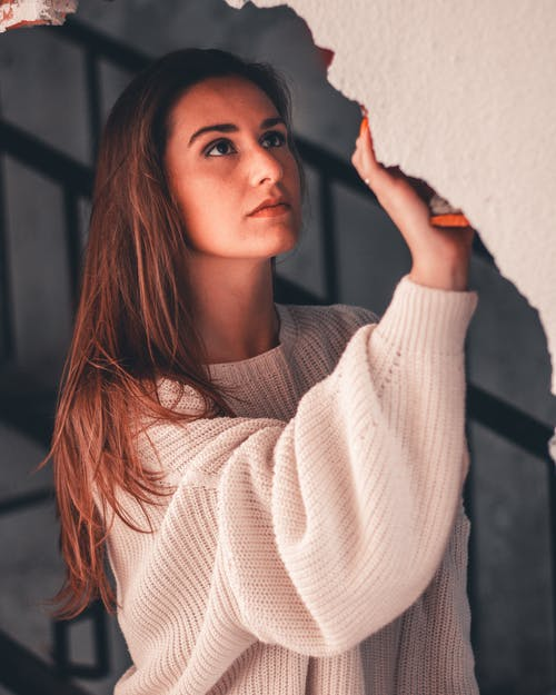 Woman Holding Wall