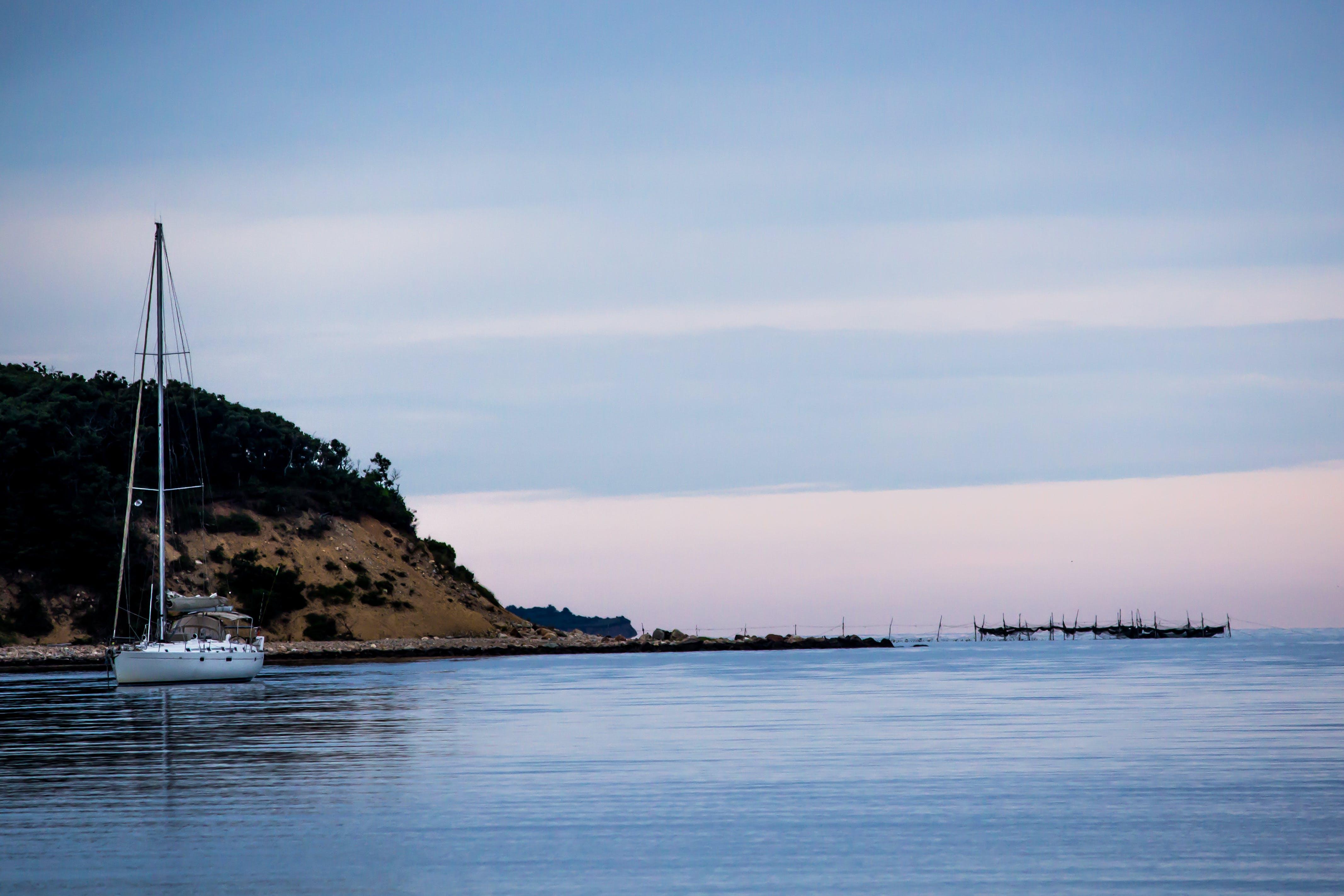 Free stock photo of beach, cliff, sailboat