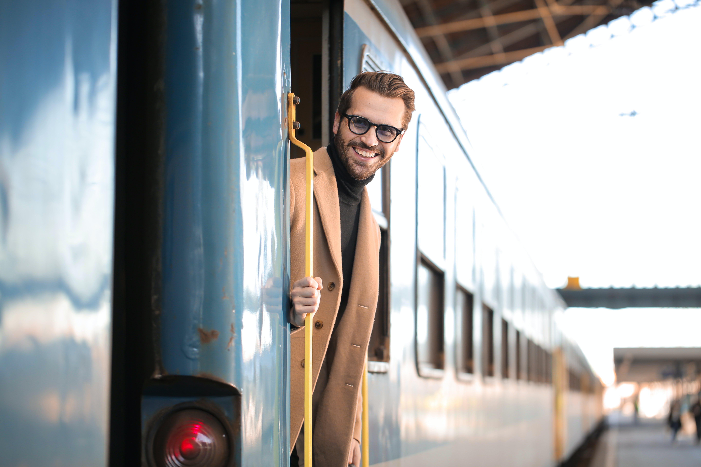 Man Wearing Brown Coat Smiling