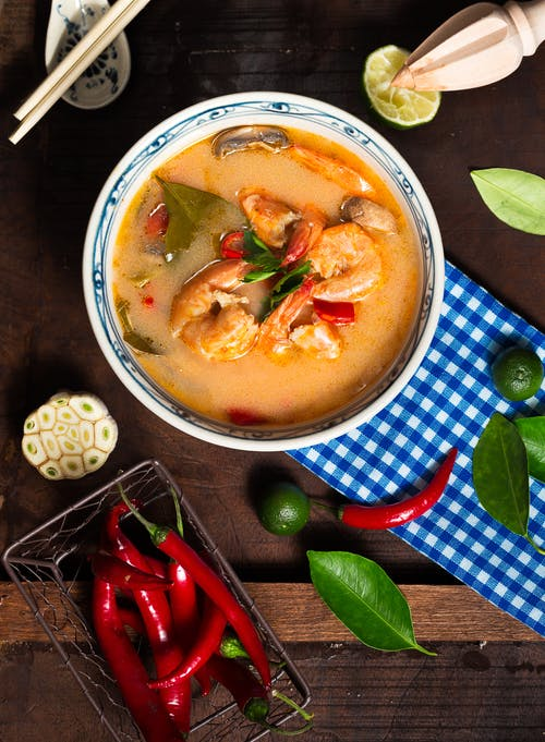 Shrimp Soup in White Ceramic Bowl With Chili on Brown Wooden Surface
